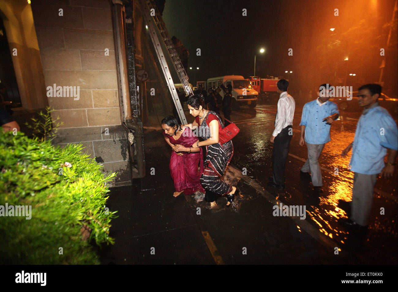 Guests and Taj personnel evacuated from Taj Mahal hotel during terrorist attack Deccan Mujahedeen ; Bombay Mumbai Stock Photo