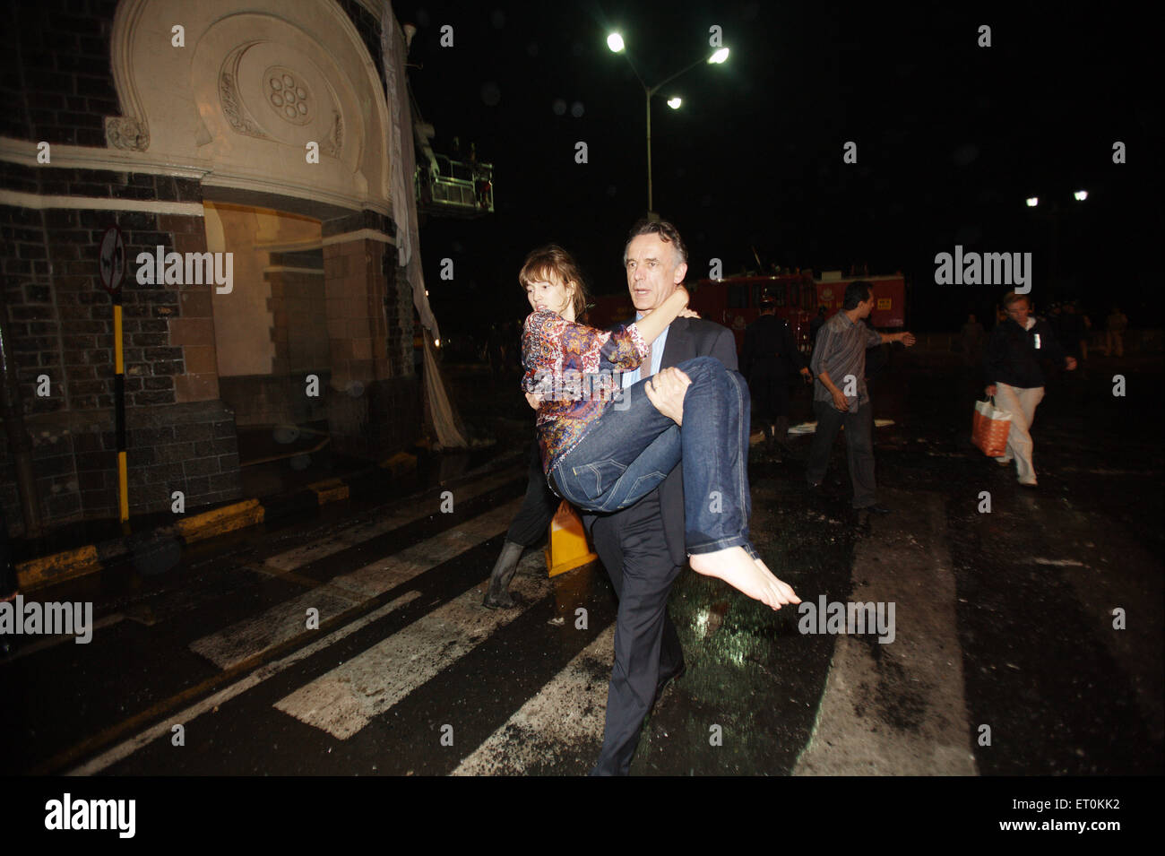 Foreign guests evacuated from Taj Mahal hotel during terrorist attack by Deccan Mujahedeen ; Bombay Mumbai Stock Photo