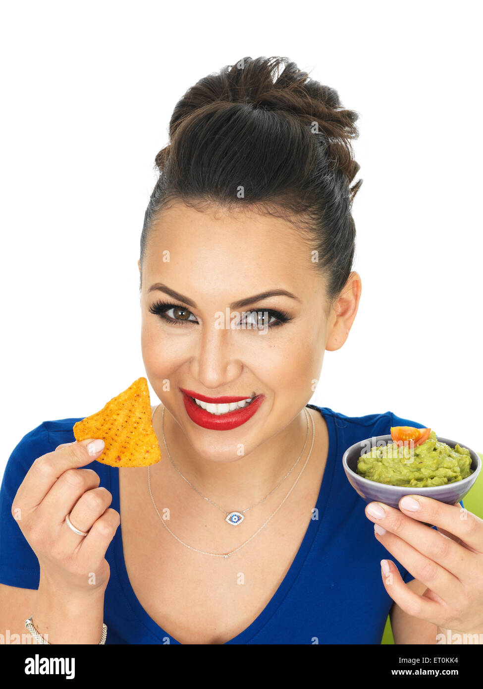 Beautiful Attractive Young Hispanic Woman Holding A Small Bowl Of Homemade Guacamole Against A White Background Stock Photo