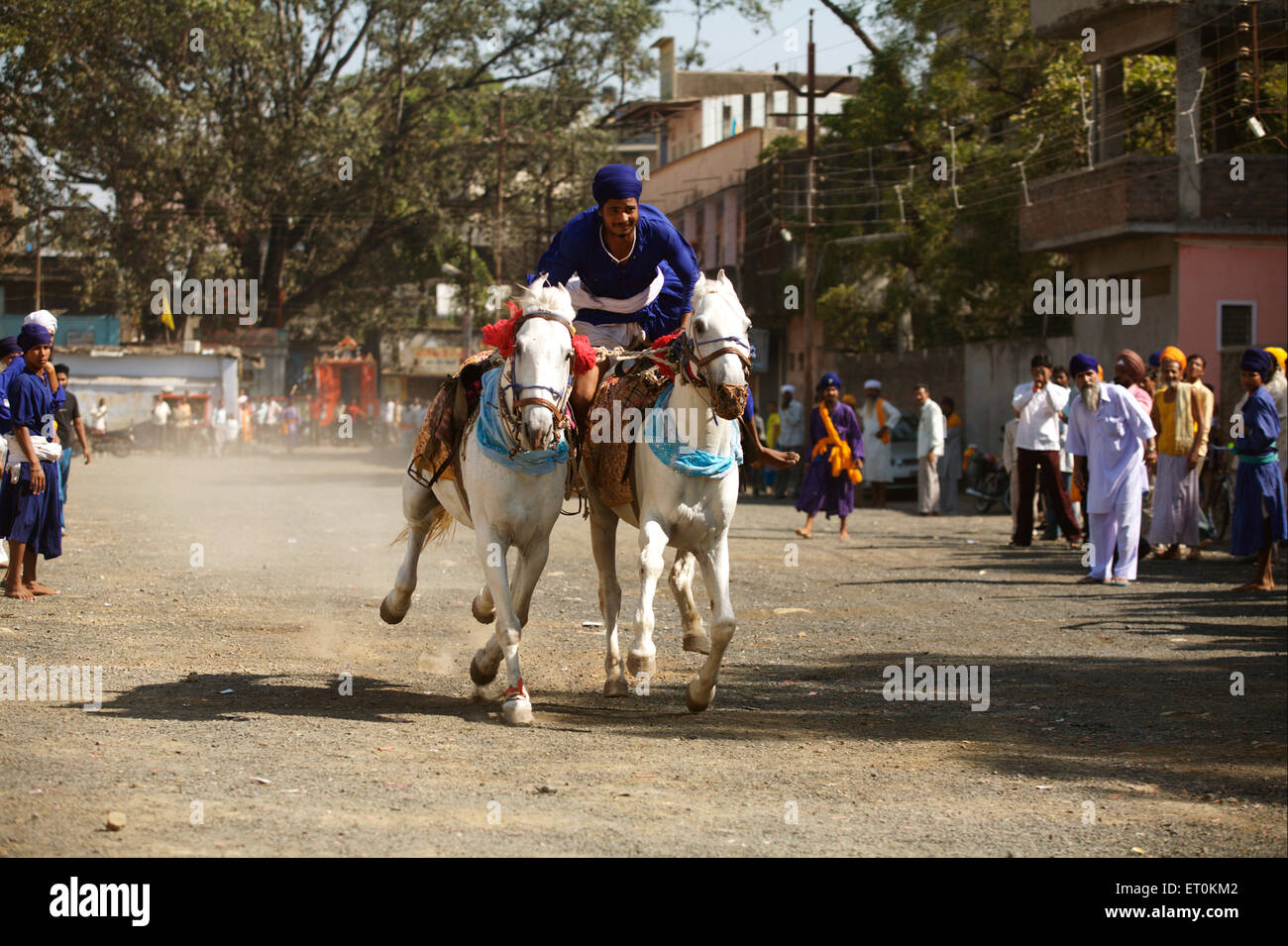Nihang or Sikh warriors performing stunts ; Consecration of perpetual Sikh Guru Granth Khalsa Sports ground in Nanded - Stock Image