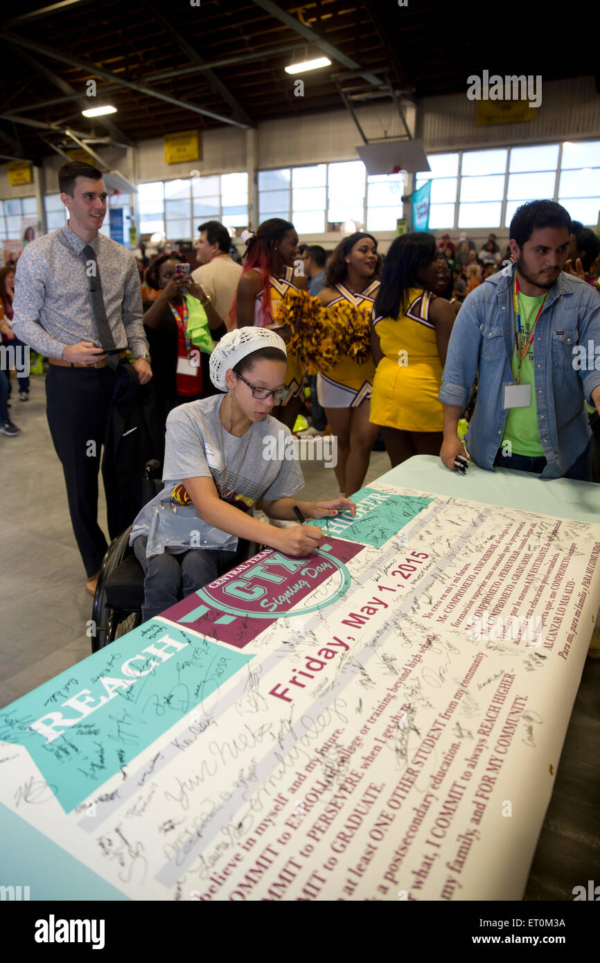 High school seniors from around Austin sign pledge to attend college during the inaugural CTX Signing Day - Stock Image