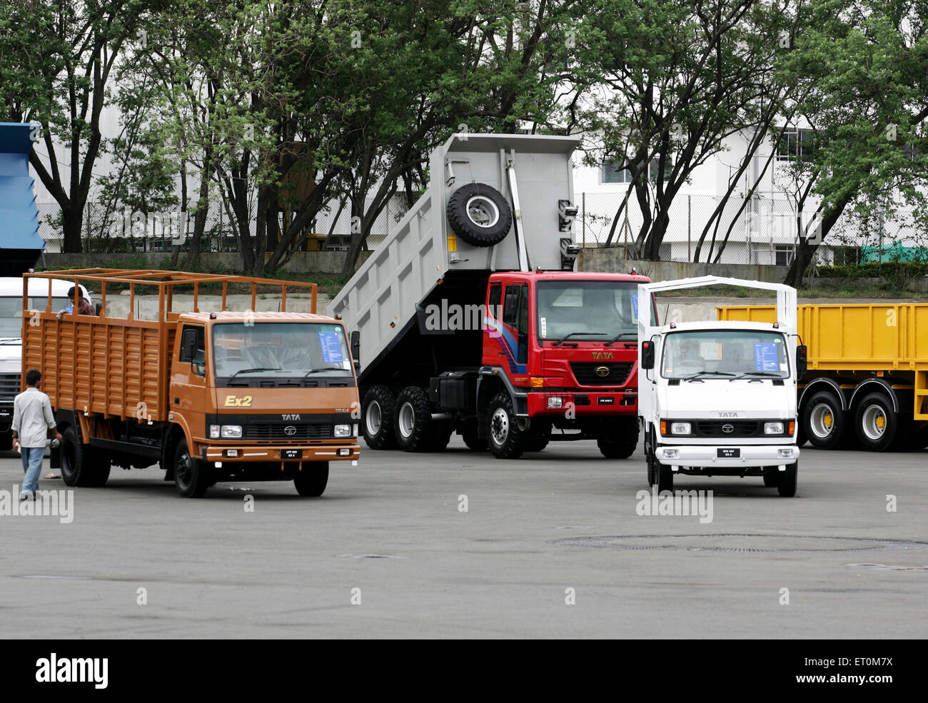 Various commercial products like matadors ; trucks parked at Tata motors plant ; Pimpri near Pune ; Maharashtra - Stock Image