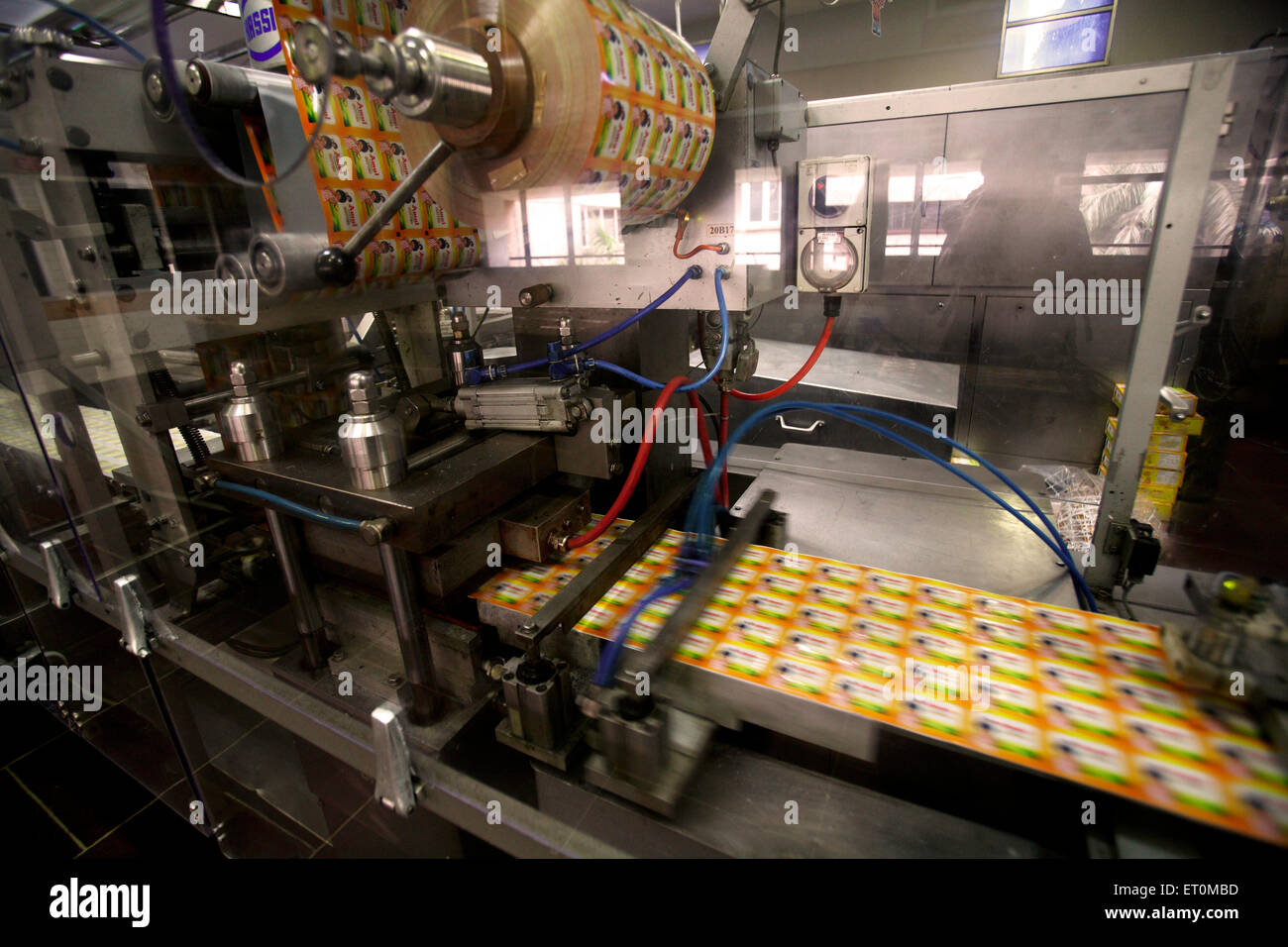 Stickers of Amul butter being printed at workshop in campus of Amul factory in Anand ; Gujarat ; India - Stock Image