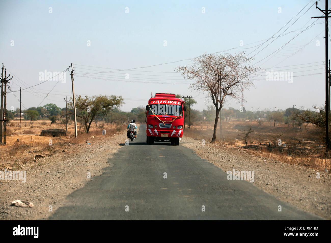 Tourist bus plying on Bhopal highway in Madhya Pradesh ; India - Stock Image