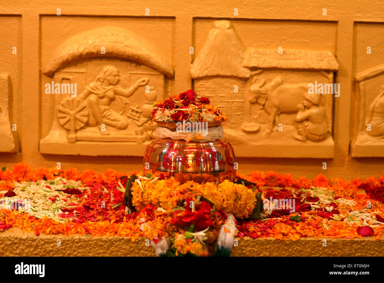 Urn containing ashes of father of nation ; Mahatma Gandhi kept amidst of flowers for public display at Mani Bhavan - Stock Image