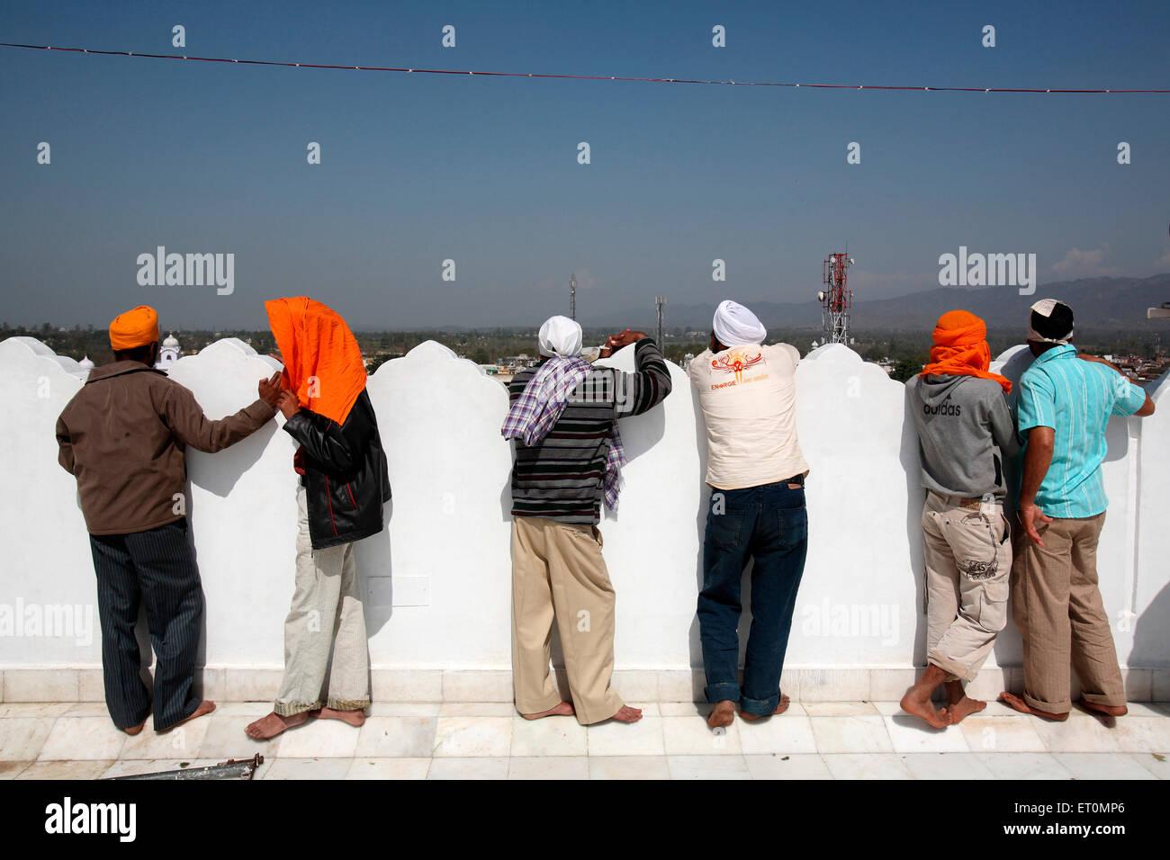 Devotees watching festivities of  Hola Mohalla  at Anandpur Sahib in Rupnagar district ; Punjab ; India - Stock Image