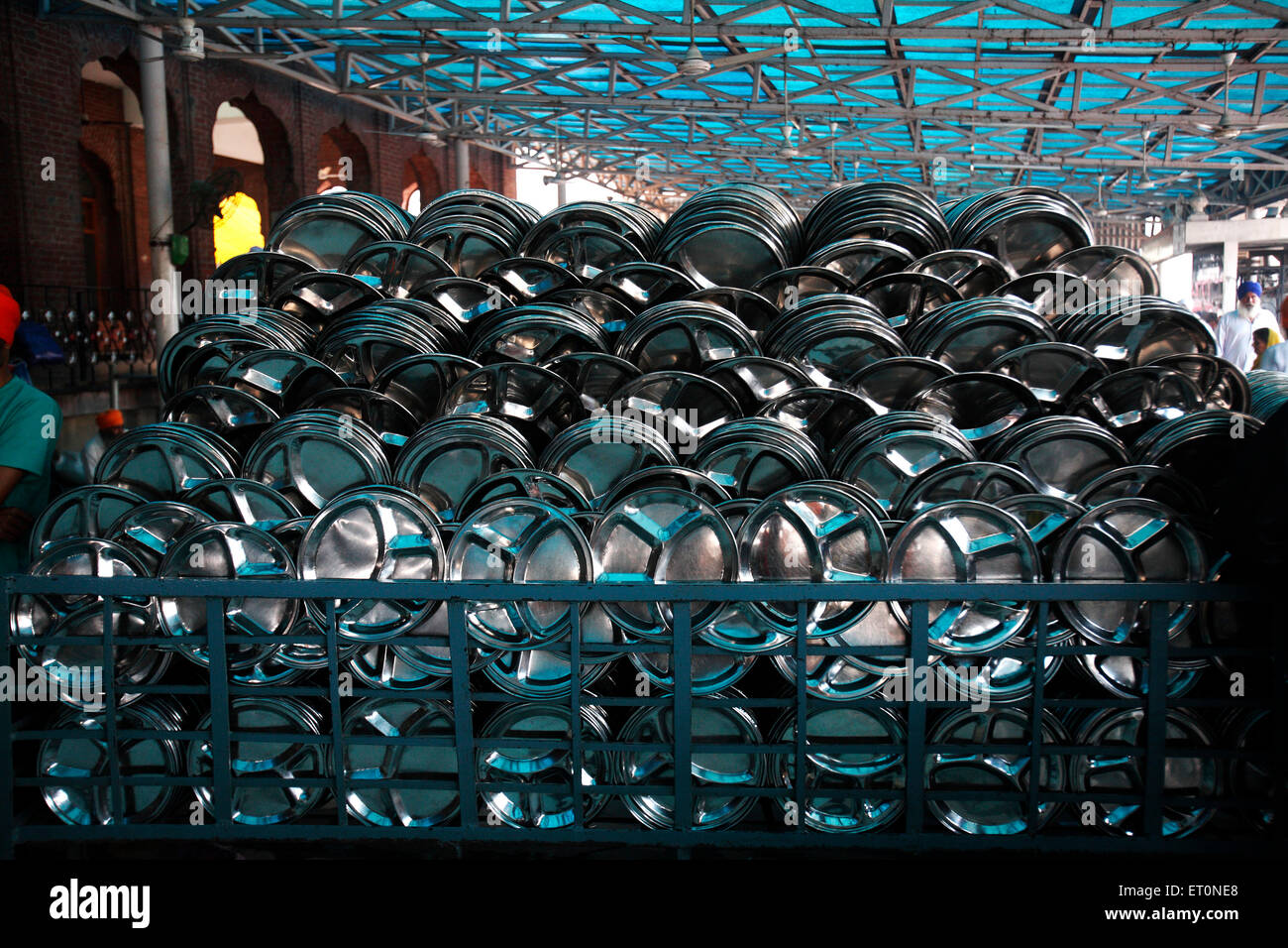 Plates used for langar or community kitchen kept for drying at Harmandir Sahib or Golden Temple in Amritsar ; Punjab - Stock Image