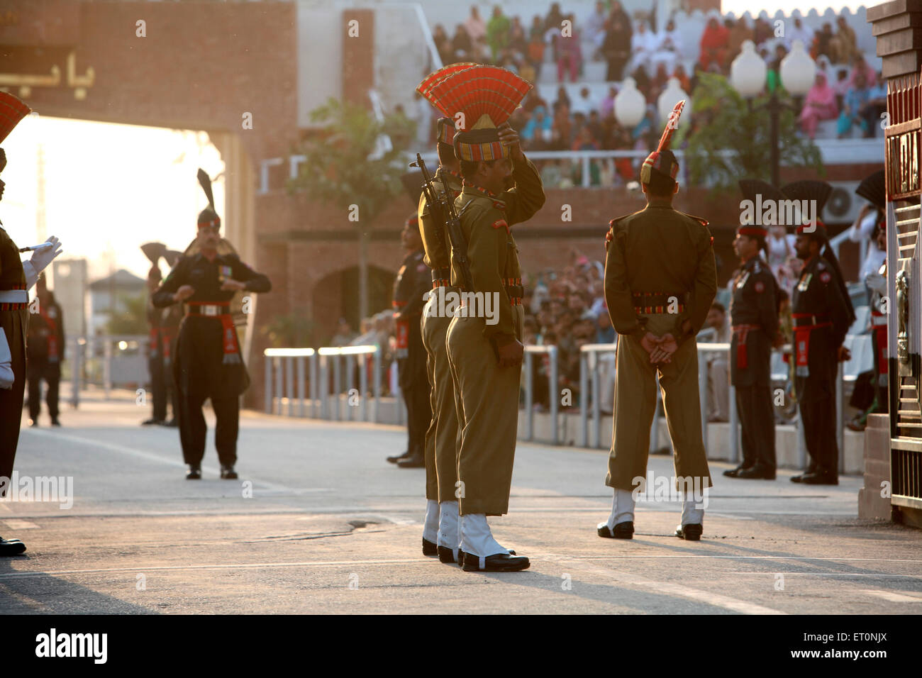 Indian border security force soldiers and Pakistani  counterpart getting geared up changing of guard ceremony at - Stock Image