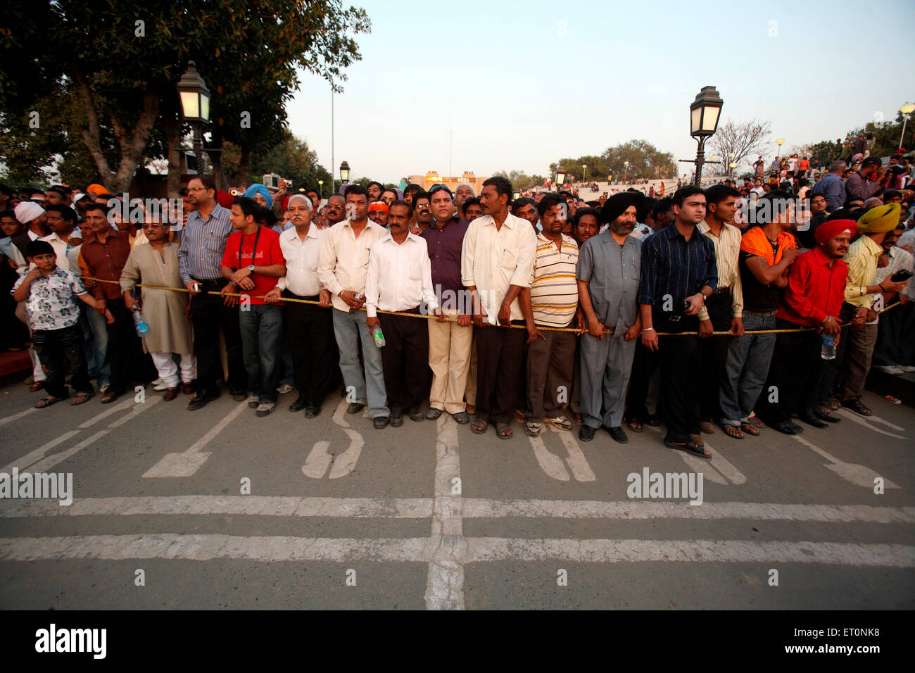 Crowds gathered to watch changing of guard ceremony at Wagah border ; Amritsar ; Punjab ; India NO MR Stock Photo