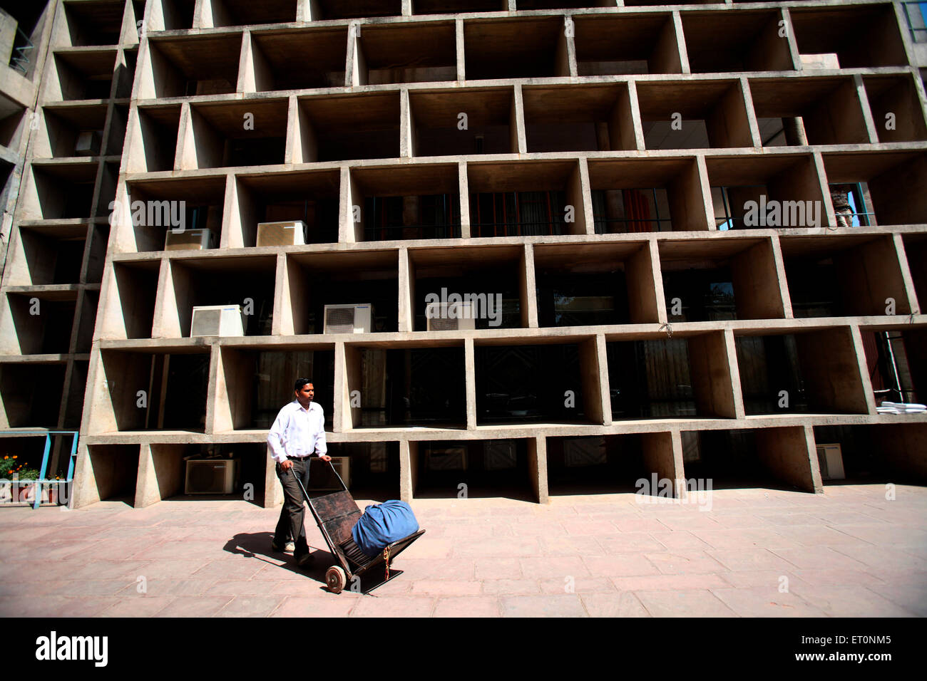 Court employee moving with papers on hand trolley at high court building of Chandigarh Union Territory  ; India - Stock Image