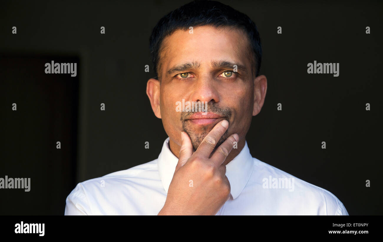 portrait of a man looking thoughtfull - Stock Image