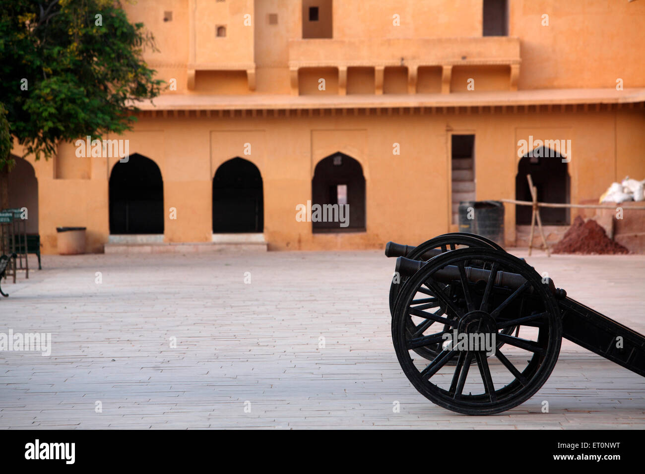 Canon kept in courtyard of Amber or  Amer fort constructed in 1592  ;  Jaipur  ; Rajasthan  ;  India - Stock Image