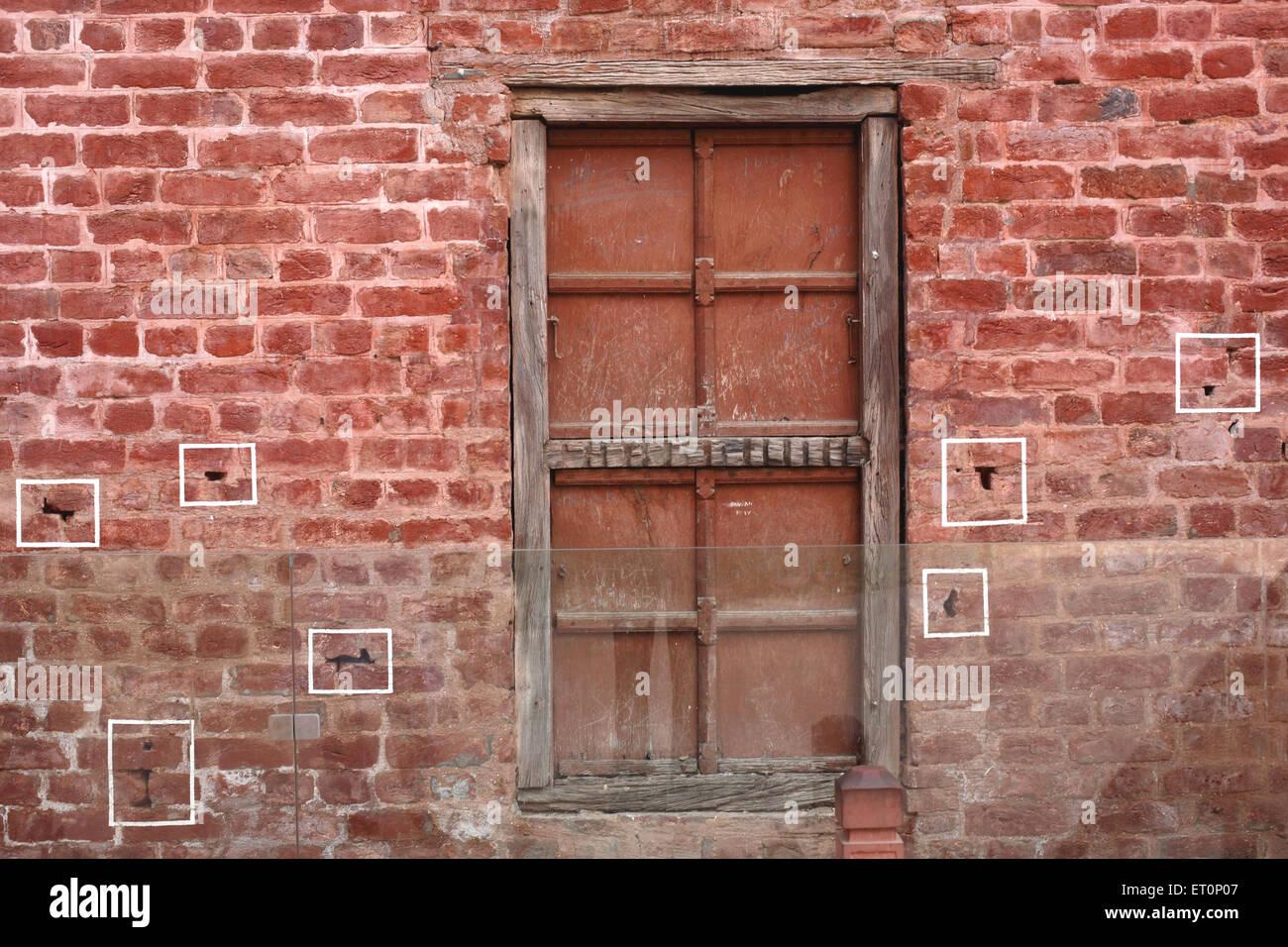 Bullet marks visible on preserved wall at Jalianwala Bagh ; Amritsar ; Punjab ; India - Stock Image
