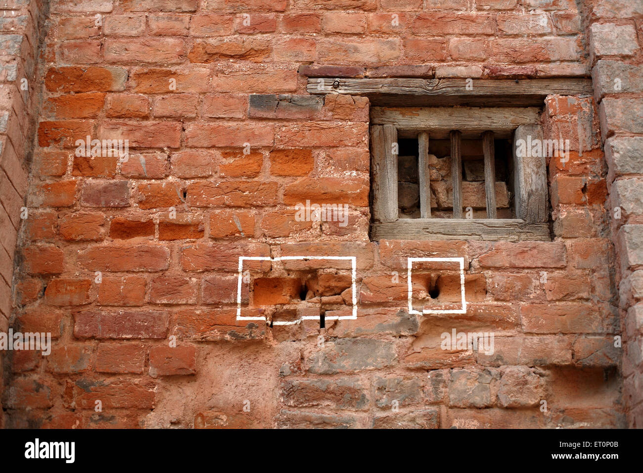 Bullet marks visible on preserved wall at Jalianwala Bagh ; Amritsar ; Punjab ; India - Stock Image