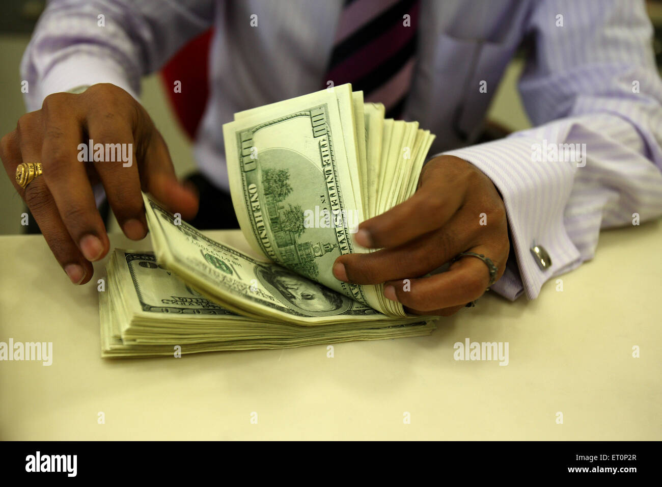 Man counting us dollars - Stock Image