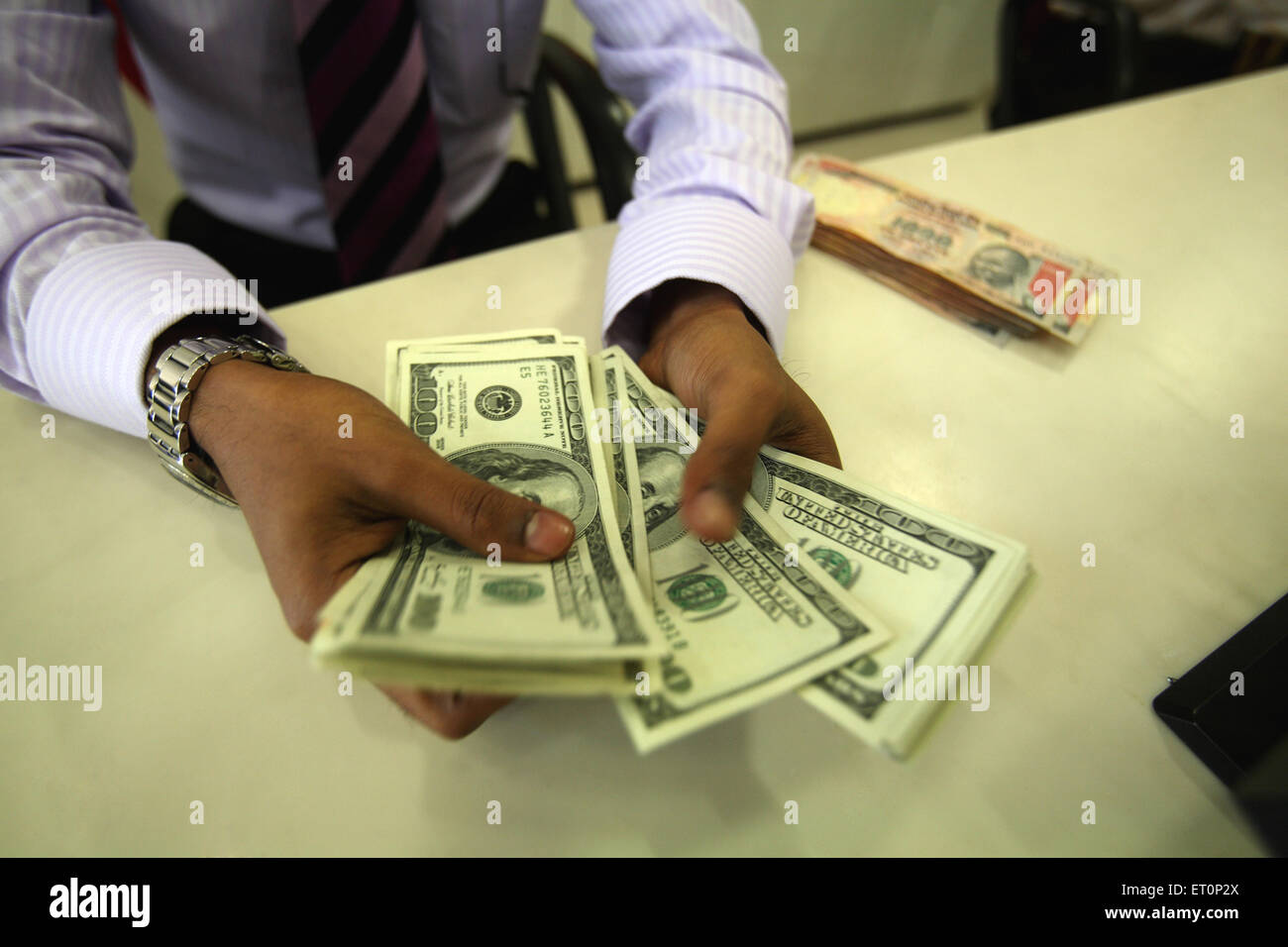 Man showing us dollars - Stock Image