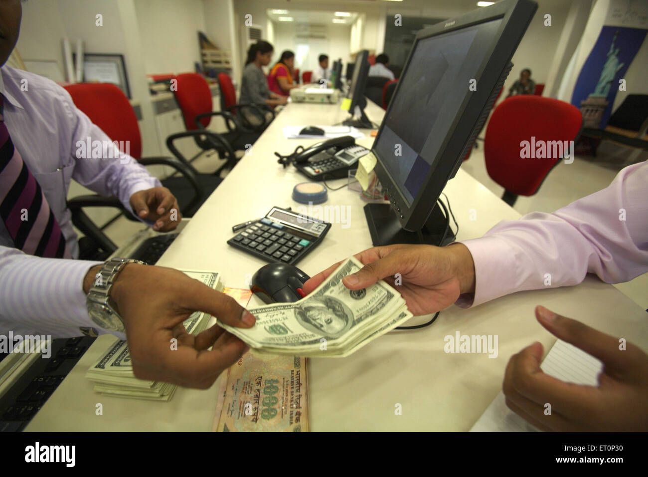 Men handing over us dollars - Stock Image