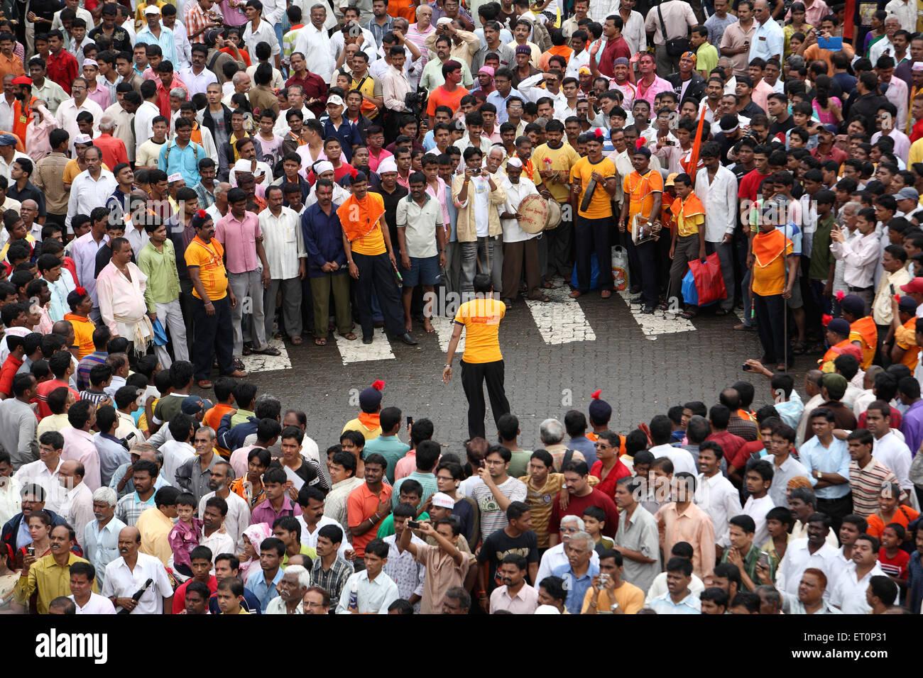 Man performing stunts during immersion of lord ganesh festival ; Bombay Mumbai ; Maharashtra; India - Stock Image