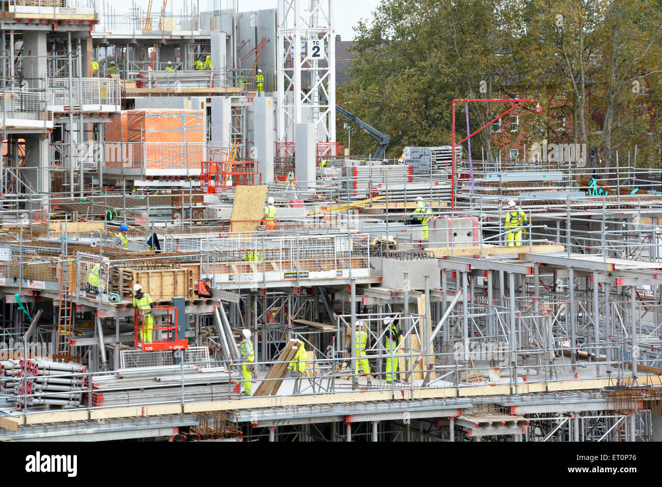 Construction site modular formwork and scaffolding units in use on construction of building superstructure South - Stock Image