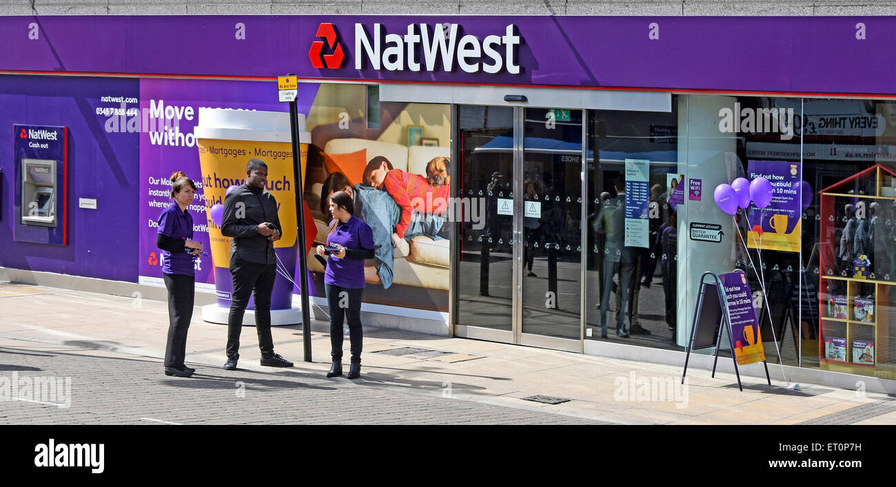 Nat West bank staff outside branch premises inviting people inside to test how much they can borrow during Mortgage - Stock Image