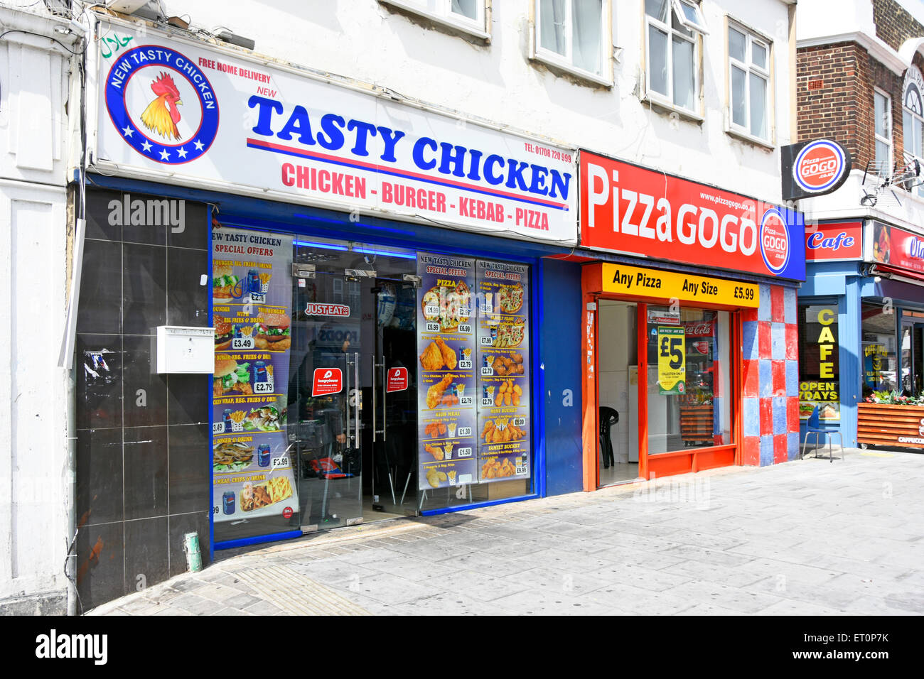 Chicken Pizza and Cafe independent business premises in competition next to each other in Romford East London England - Stock Image