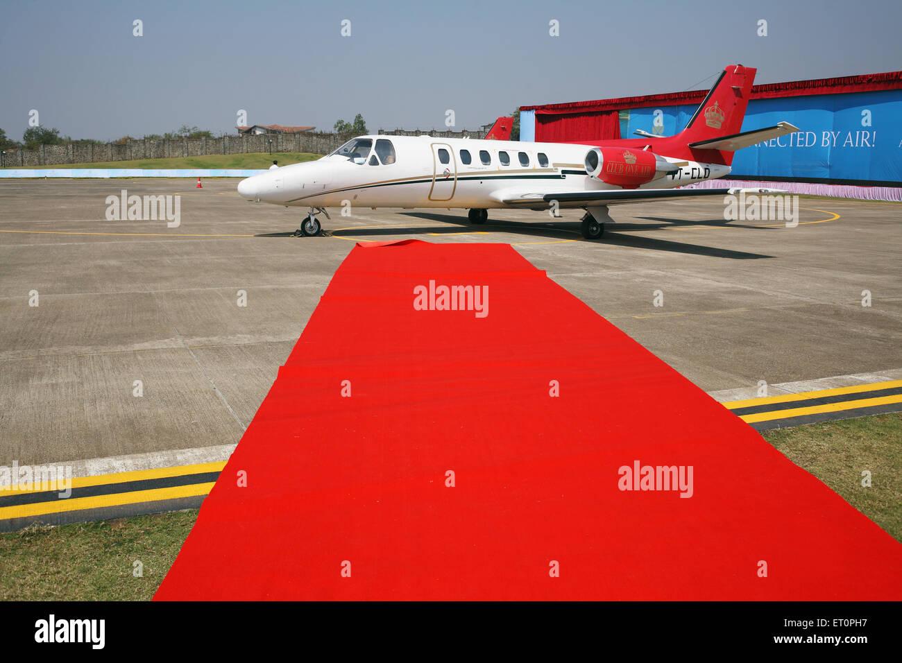 Red carpet for passengers of inaugural flight at aamby valley airport ; Lonavala ; Maharashtra ; India - Stock Image