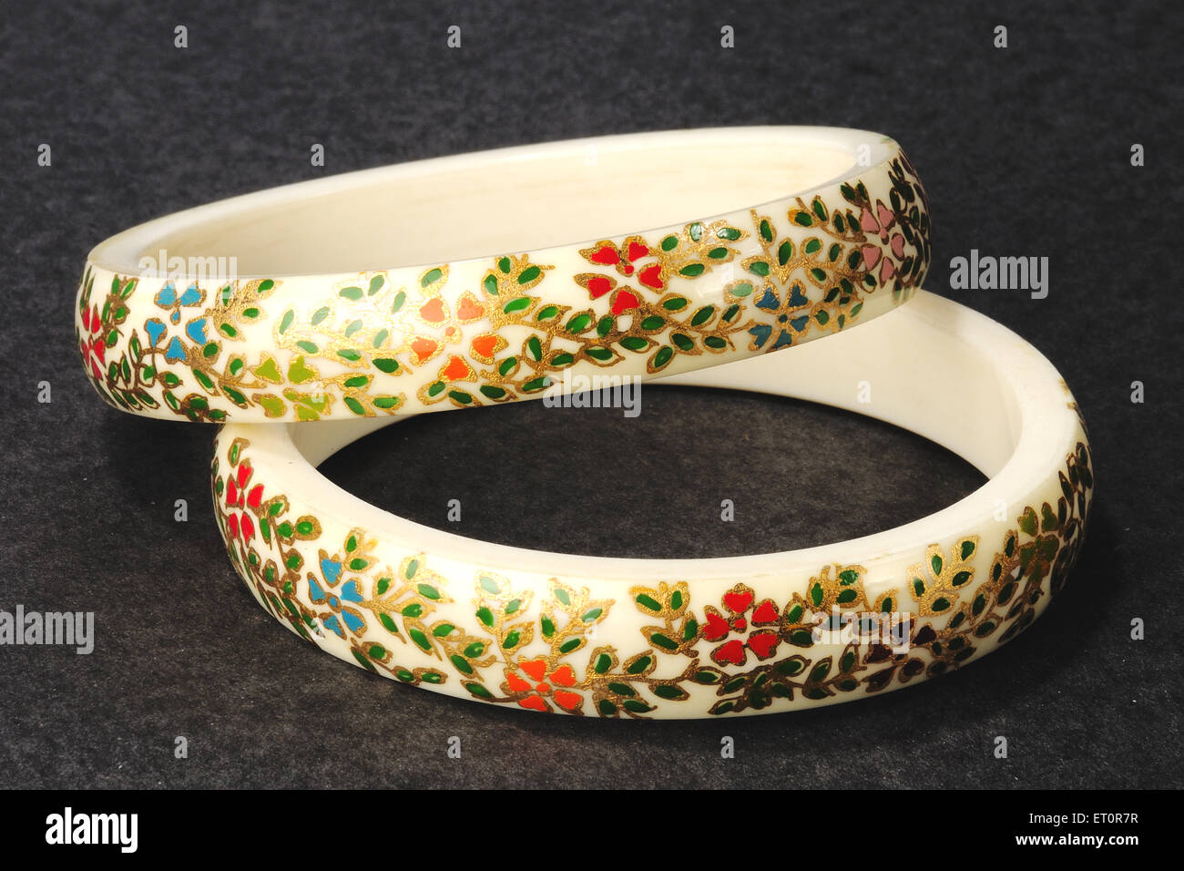 Designer bangles black background ; India - Stock Image