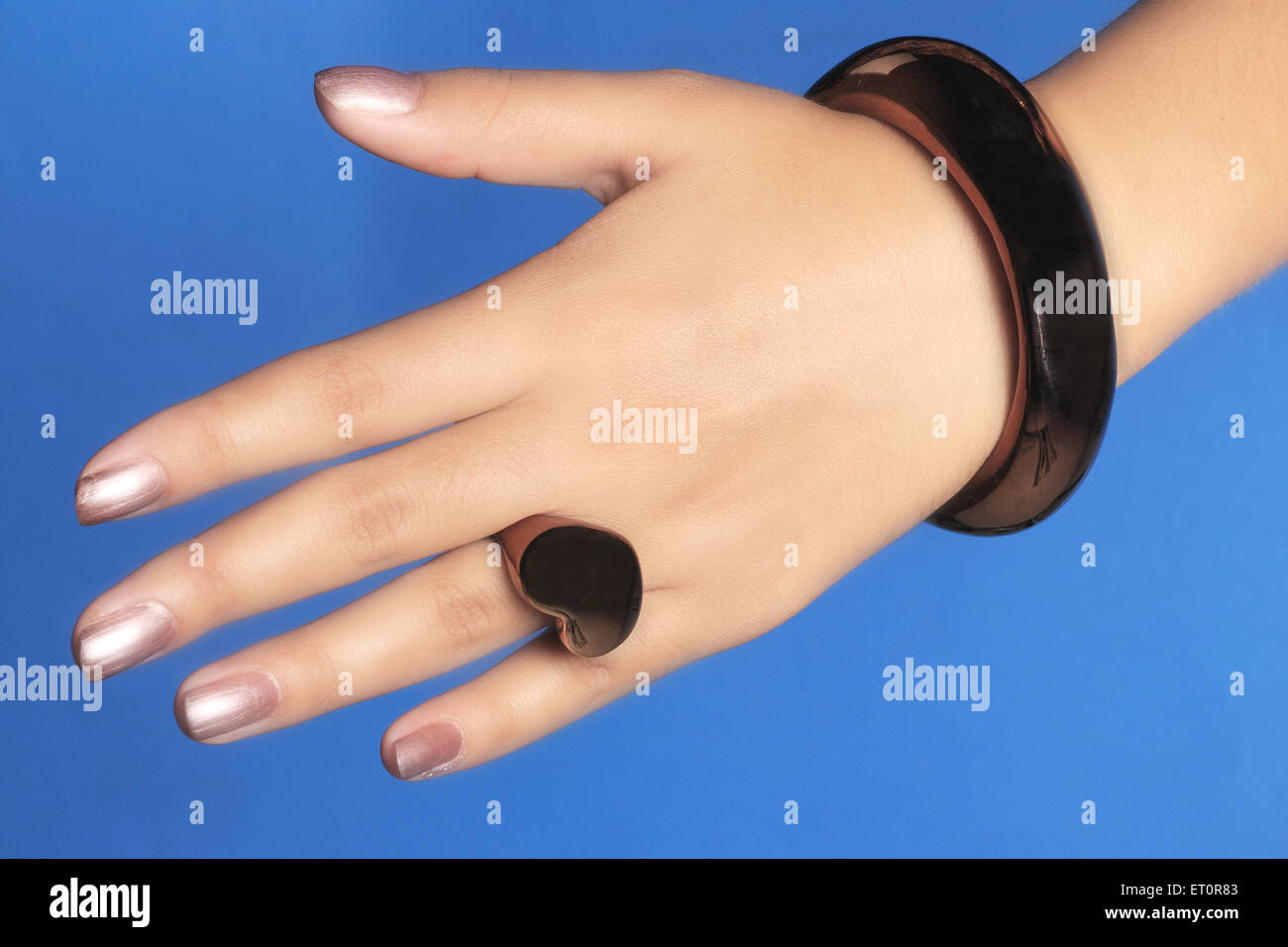 Bangle in woman  hand ; India - Stock Image