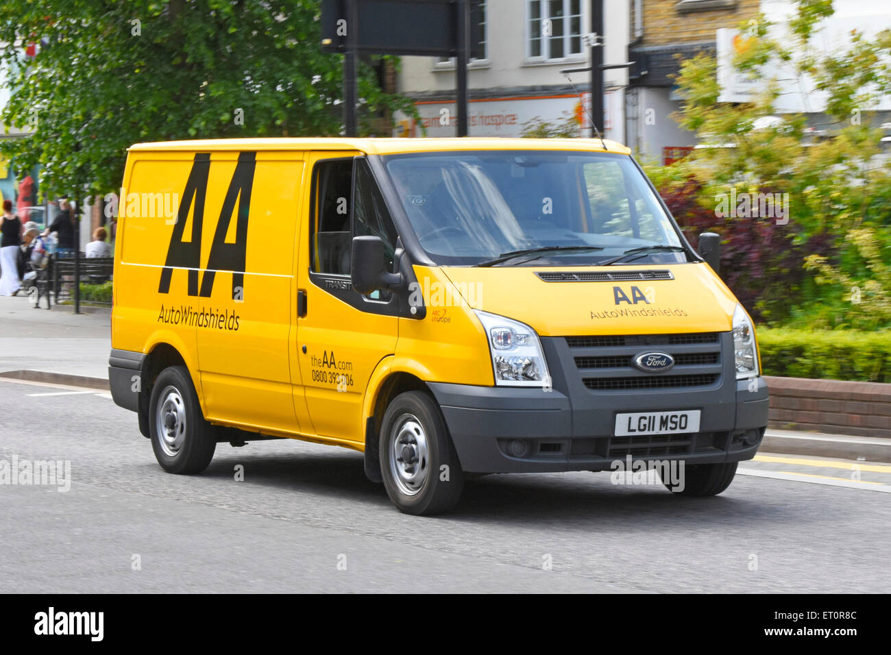 AA breakdown van driving along town centre high street deals with Auto Windshield repairs and breakdowns Brentwood - Stock Image