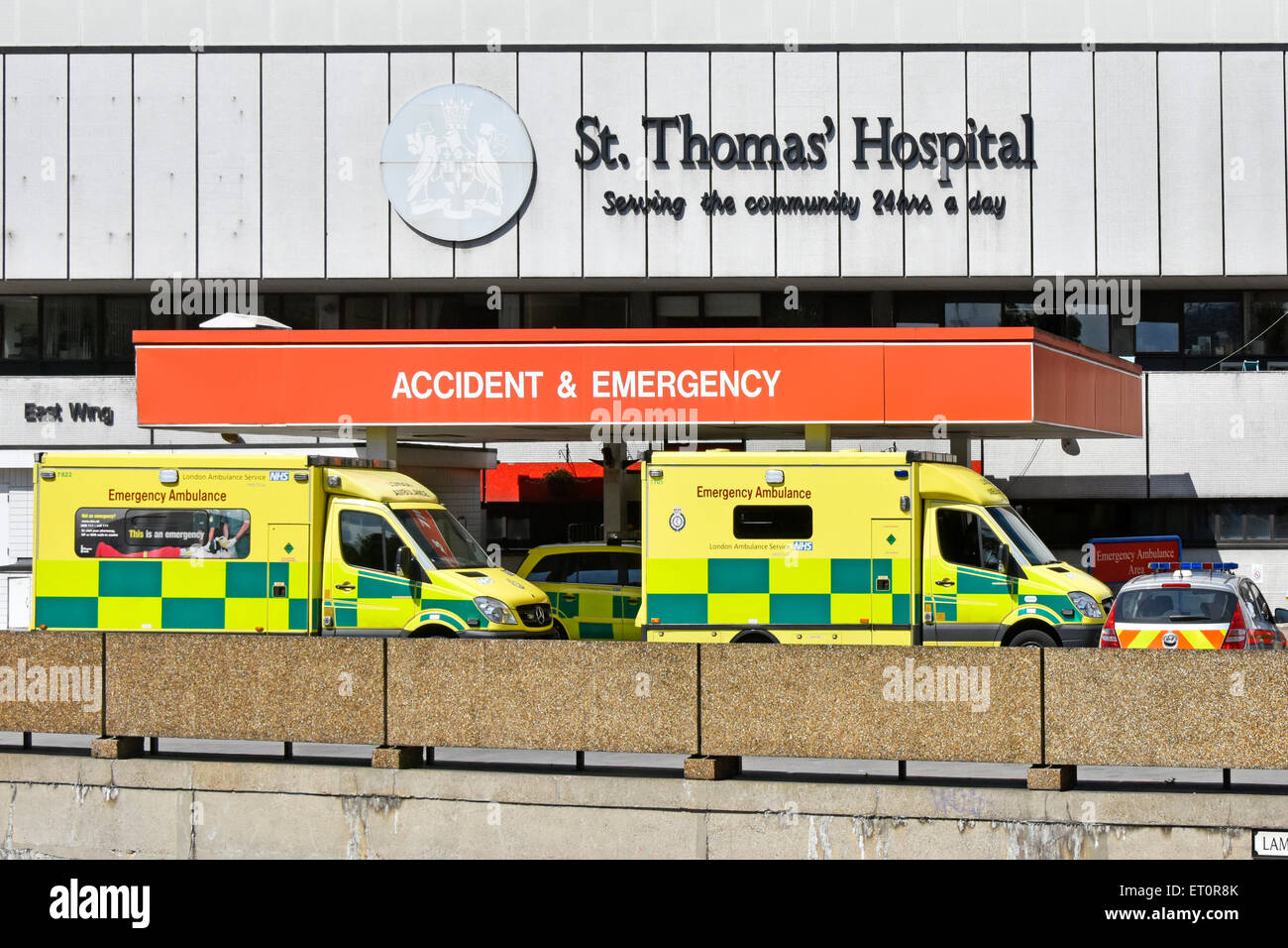 NHS emergency ambulances  and police car at hospital A& E department entrance St Thomas Hospital Lambeth London - Stock Image