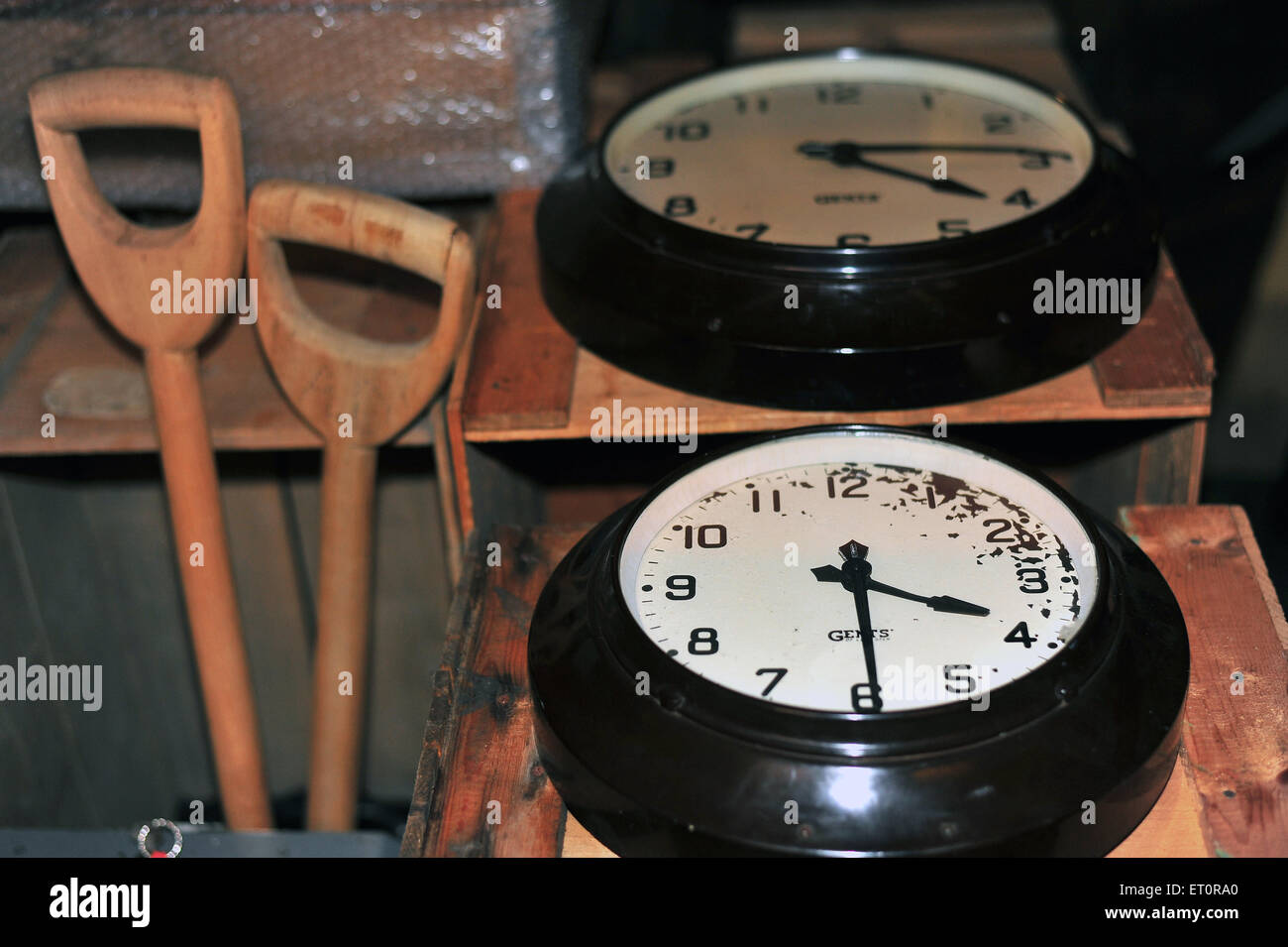 Clocks and gardening tools kept inside the storage warehouse of the M Shed museum in Bristol. - Stock Image