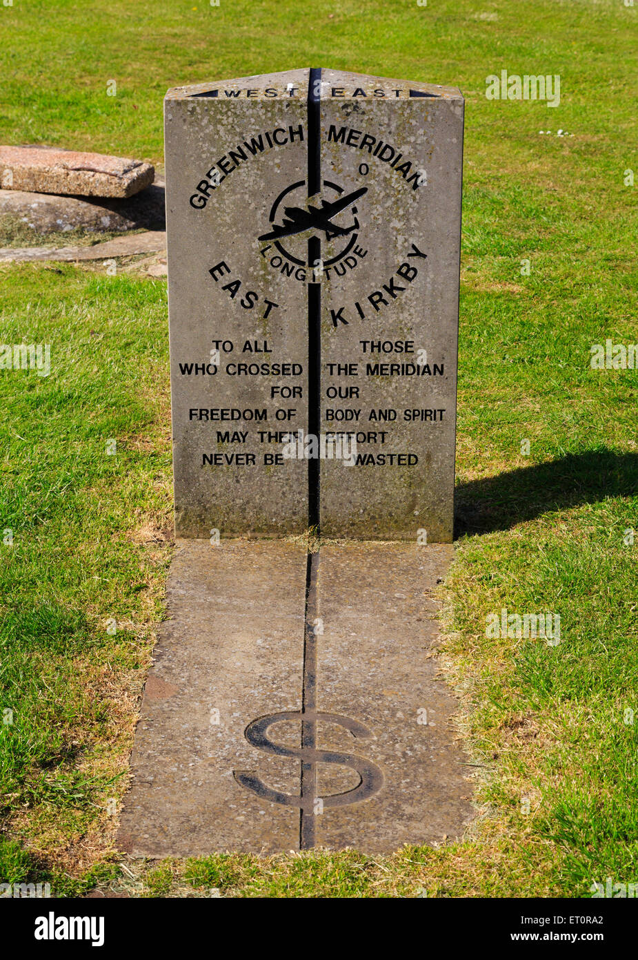 Greenwich meridian memorial stone at East Kirkby Aviation Heritage Centre. Lincolnshire. - Stock Image