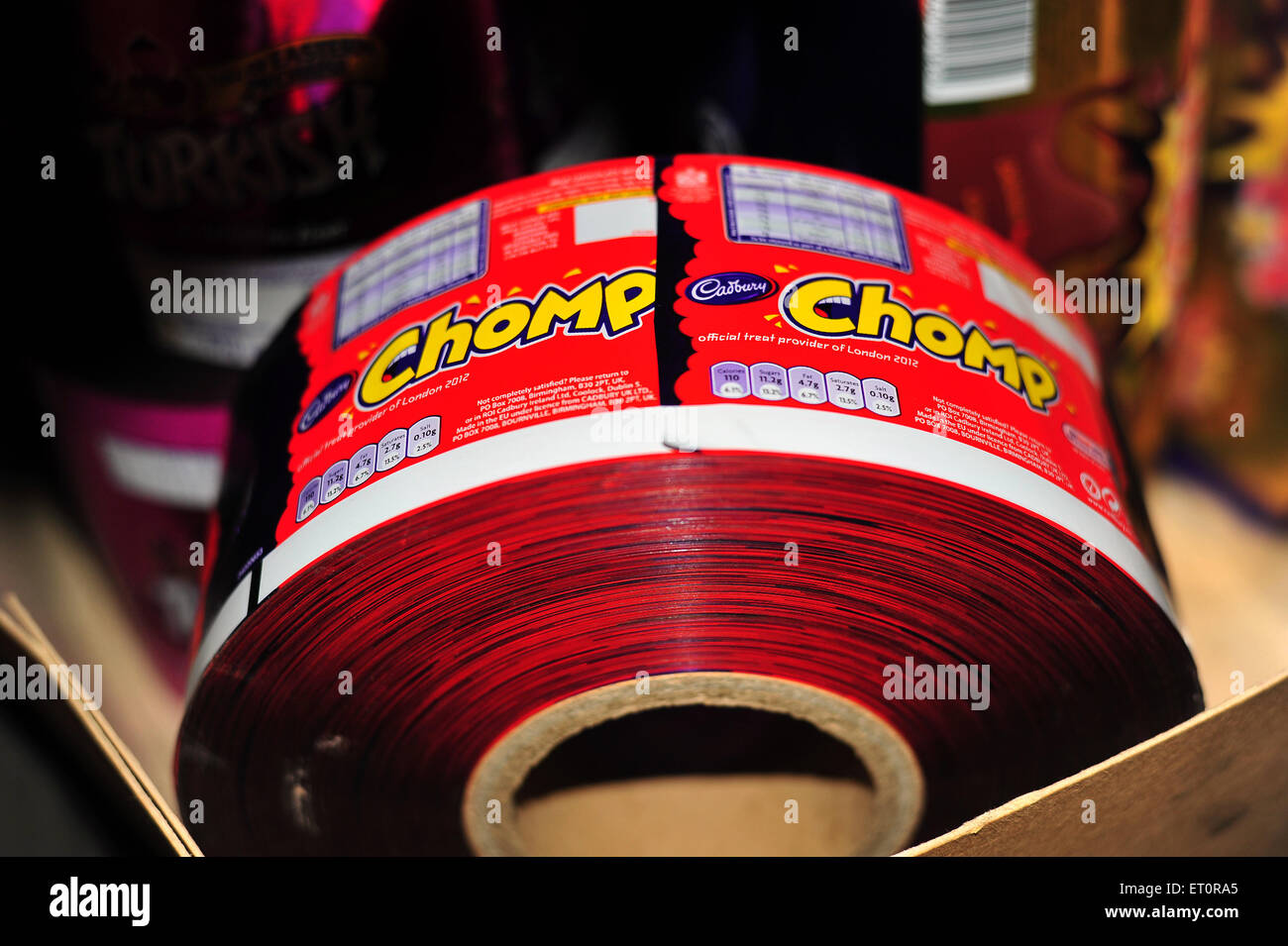 A roll of Cadbury Chomp chocolate bar wrappers in the storage warehouse for the M Shed museum in Bristol. - Stock Image