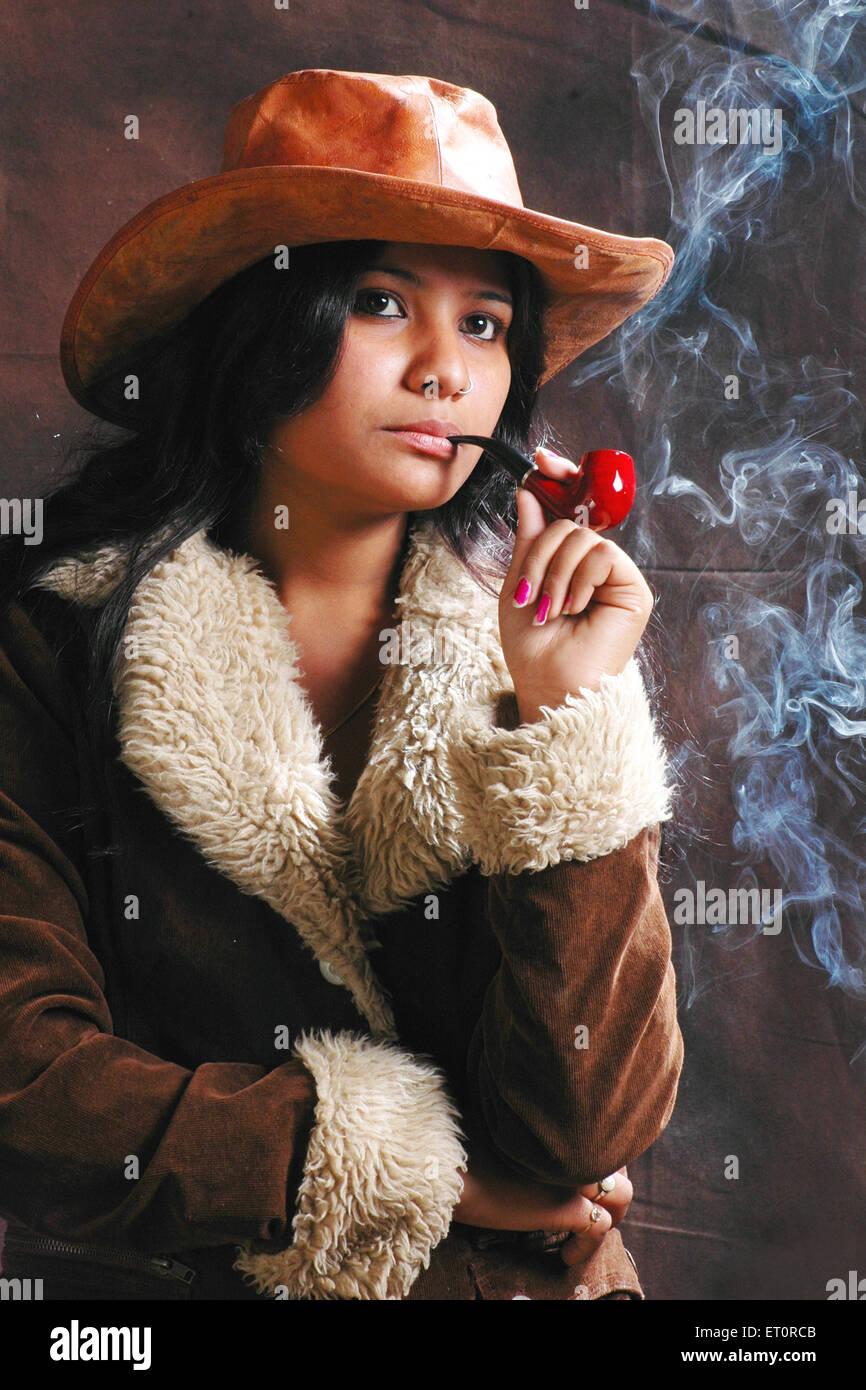 Lady smoking cigar MR#769E - Stock Image