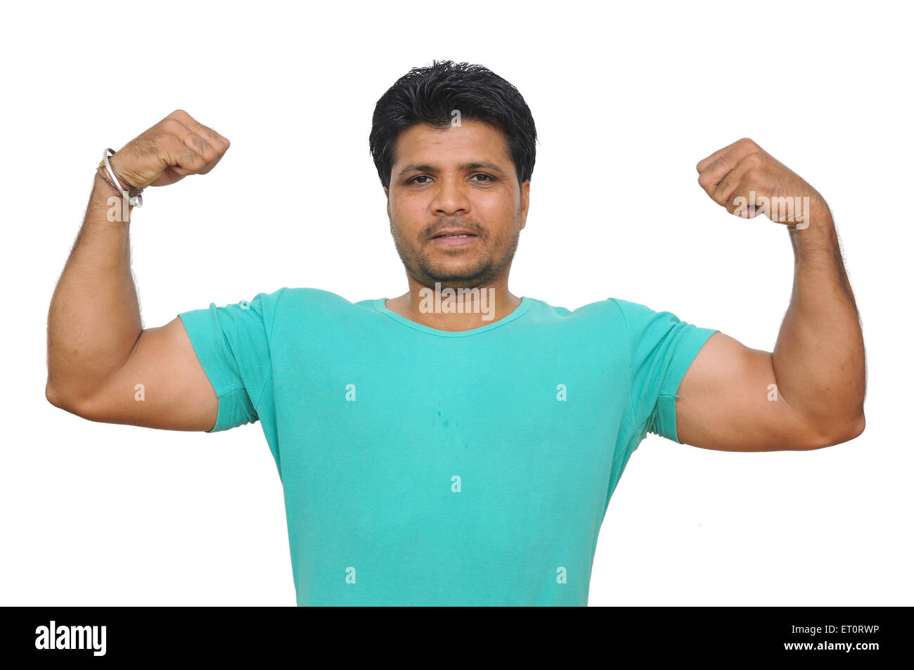 Man showing biceps on white background MR#786 - Stock Image