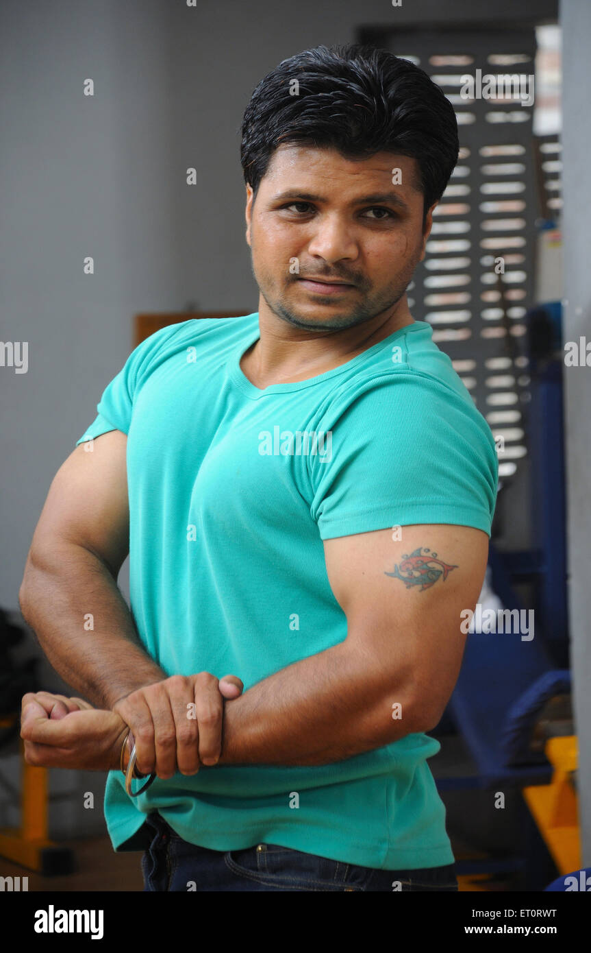 Man showing biceps MR#786 - Stock Image