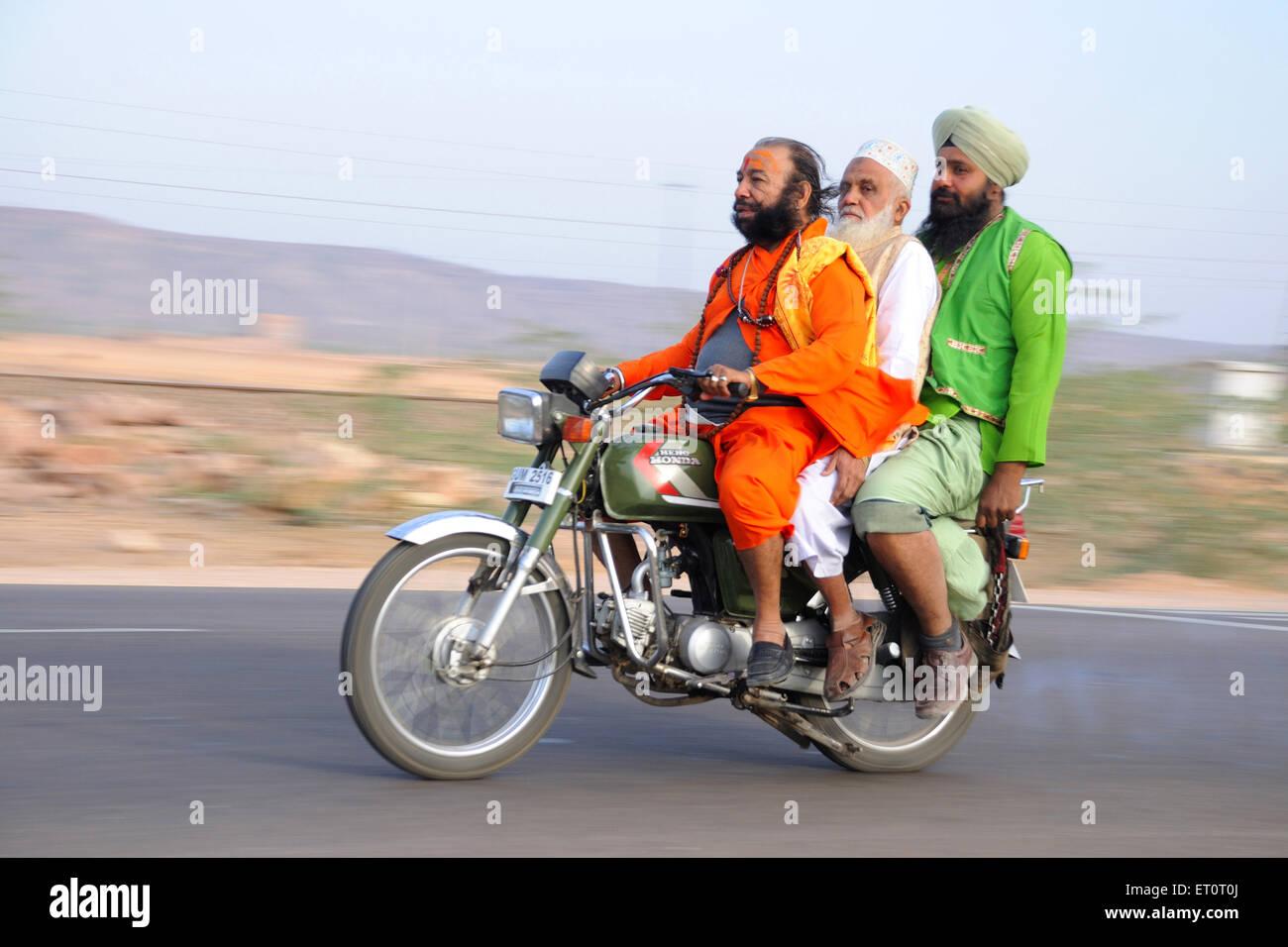 Men on motorbike NOMR - Stock Image