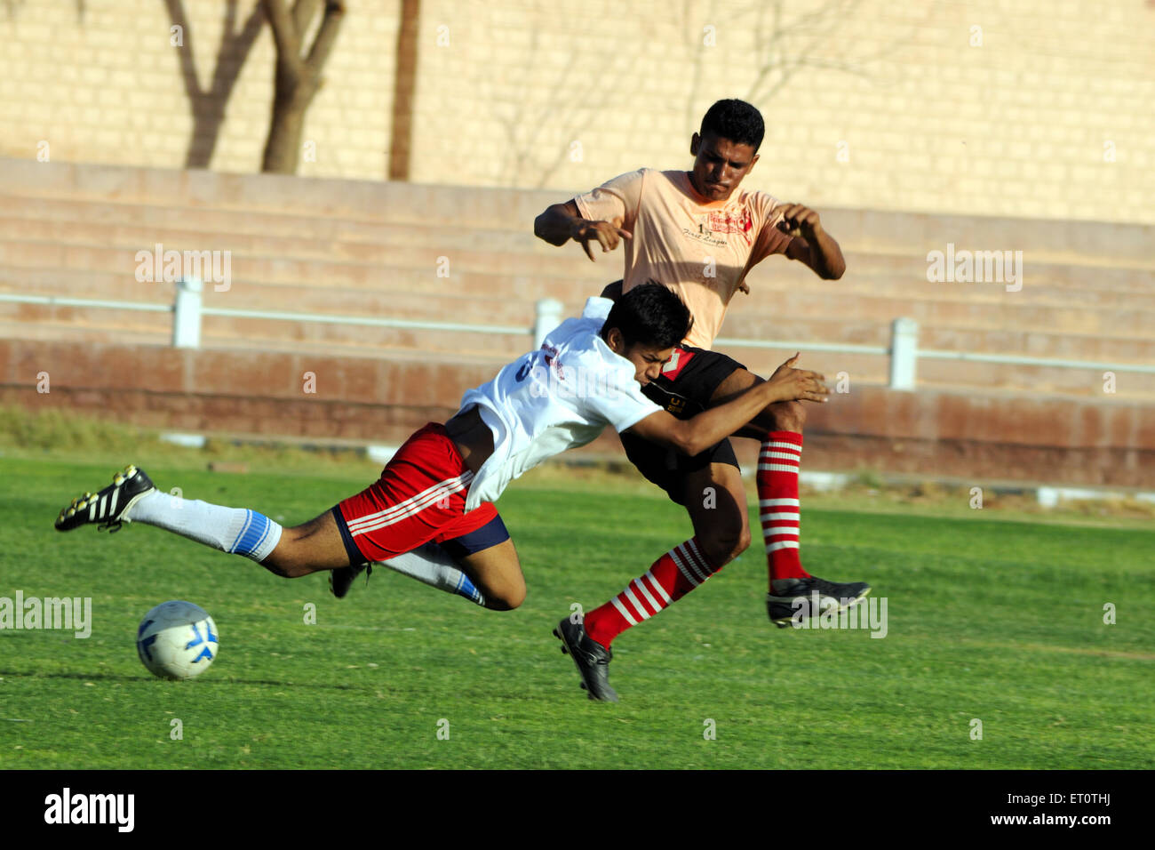 Playing soccer match MR#786 - Stock Image