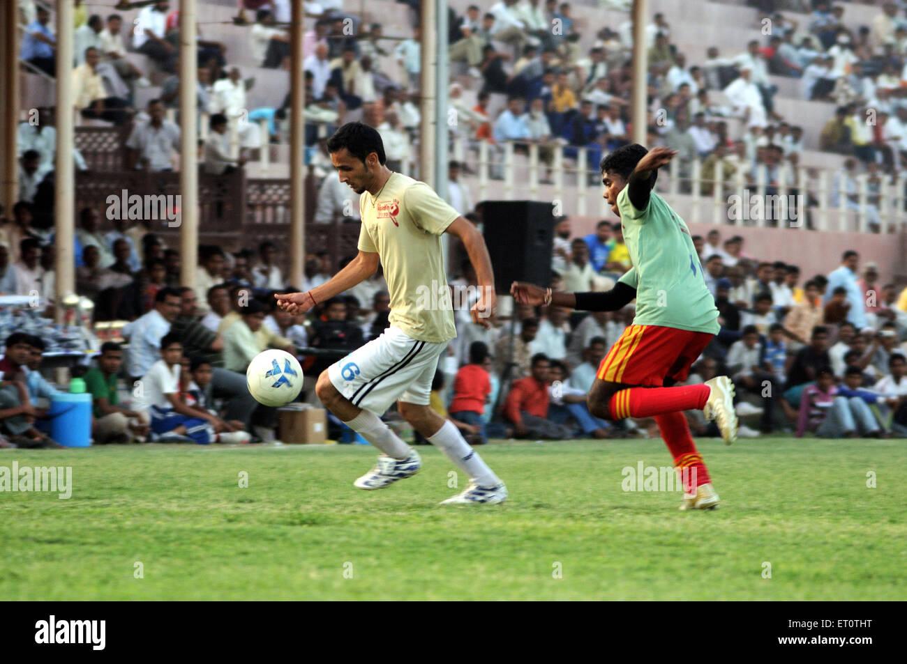 Playing soccer match MR#786 Stock Photo