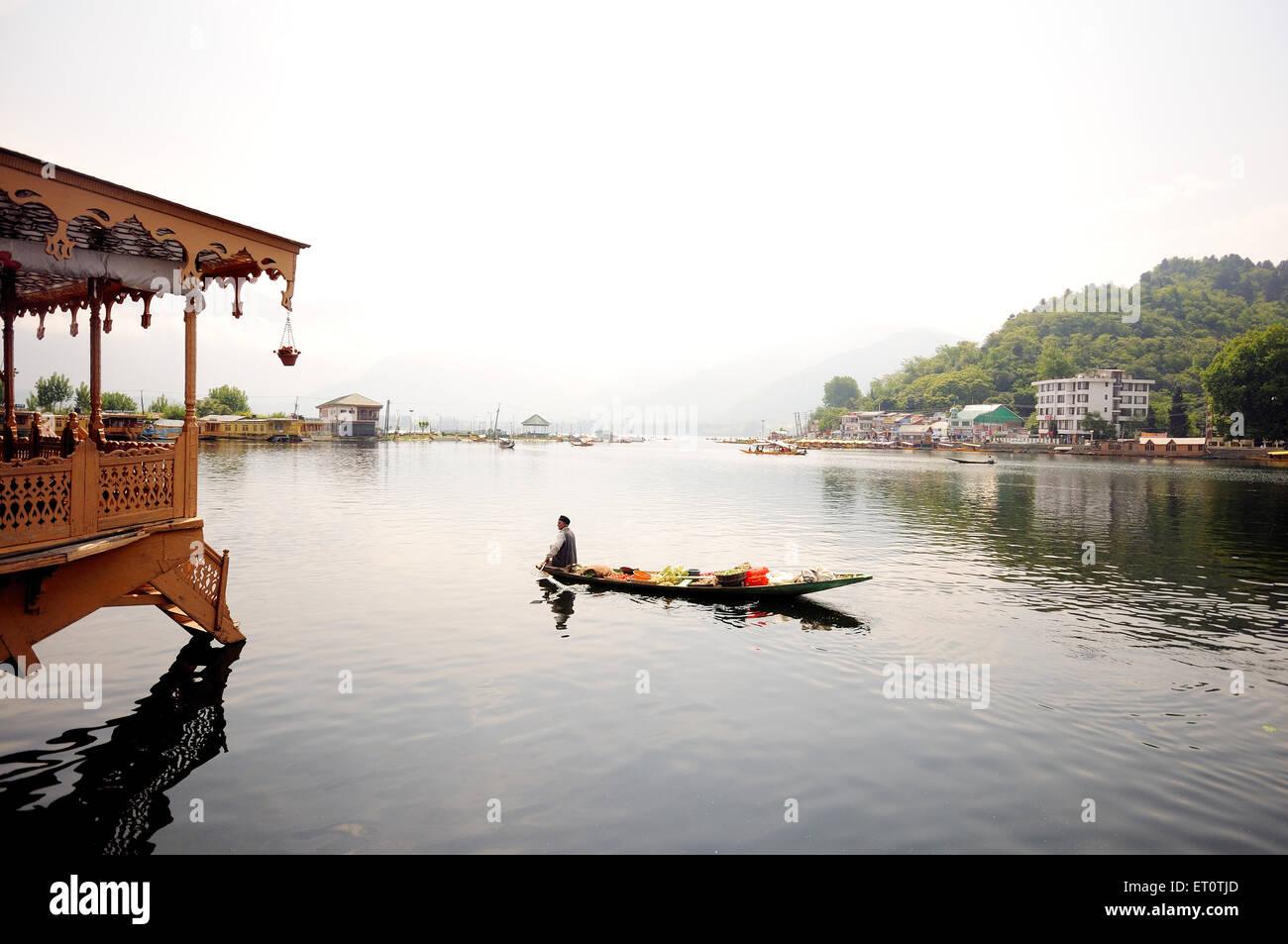 Houseboat and canoe in dal lake ; Srinagar ; Jammu and Kashmir ; India - Stock Image