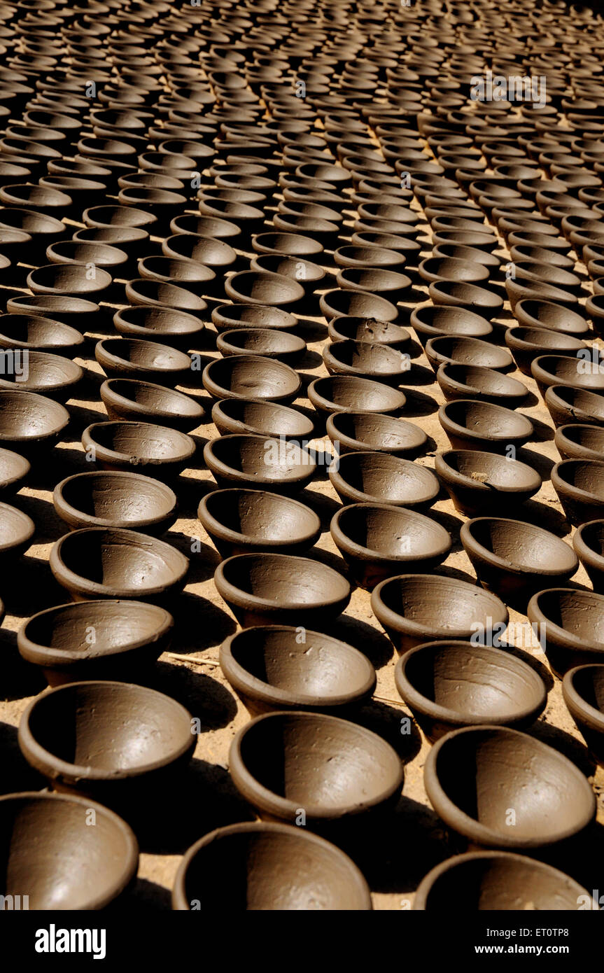 Oil lamps in a row ; Rajasthan ; India Stock Photo