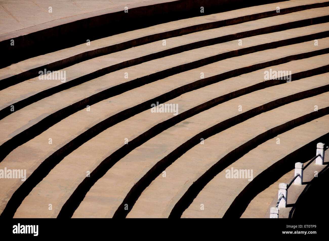 Sitting arrangement of a ground steps like shadow pattern ; India - Stock Image
