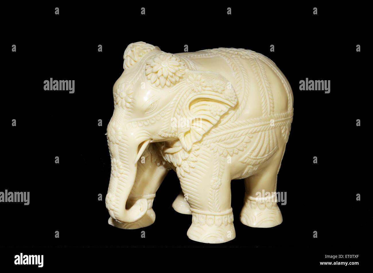 Elephant made by elephants tusk on black background - Stock Image