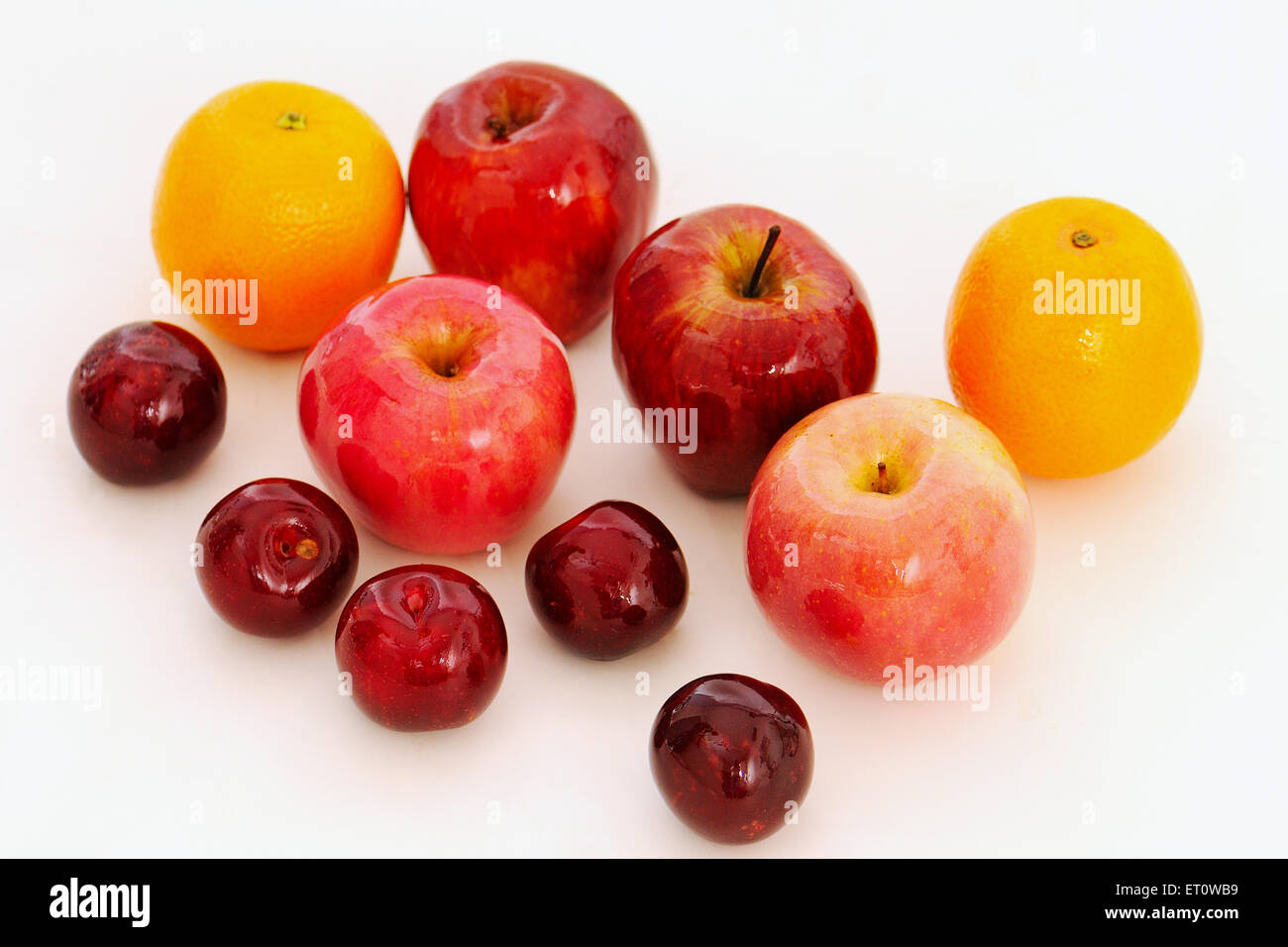 Fruits ; apples ; oranges and plums on white background ; India - Stock Image