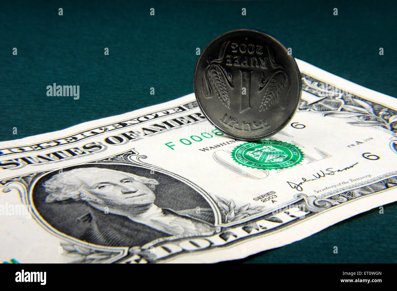 concept of Indian Rupee coin and American Dollar note - Stock Image