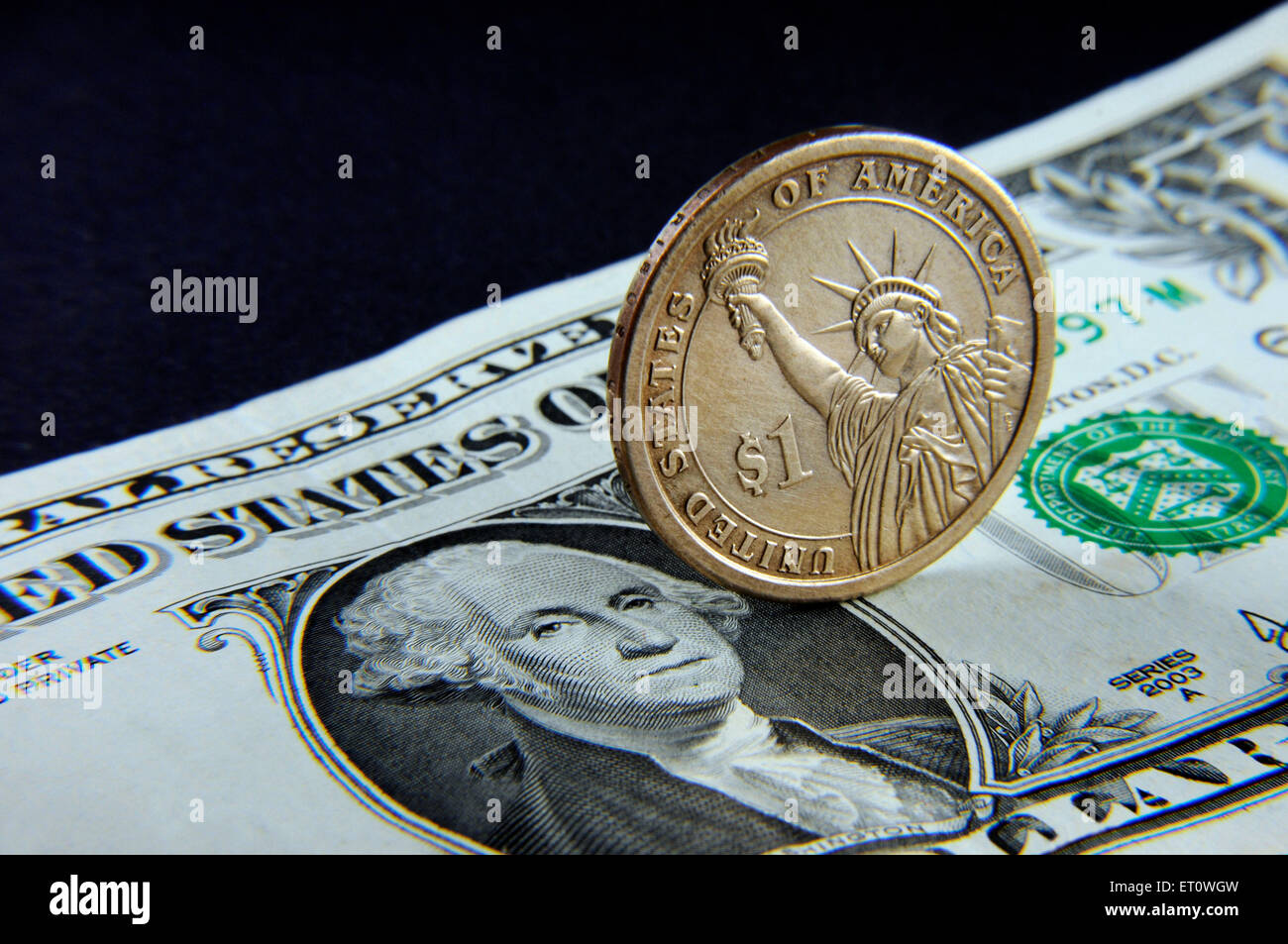 concept of American Dollar note and coin - Stock Image