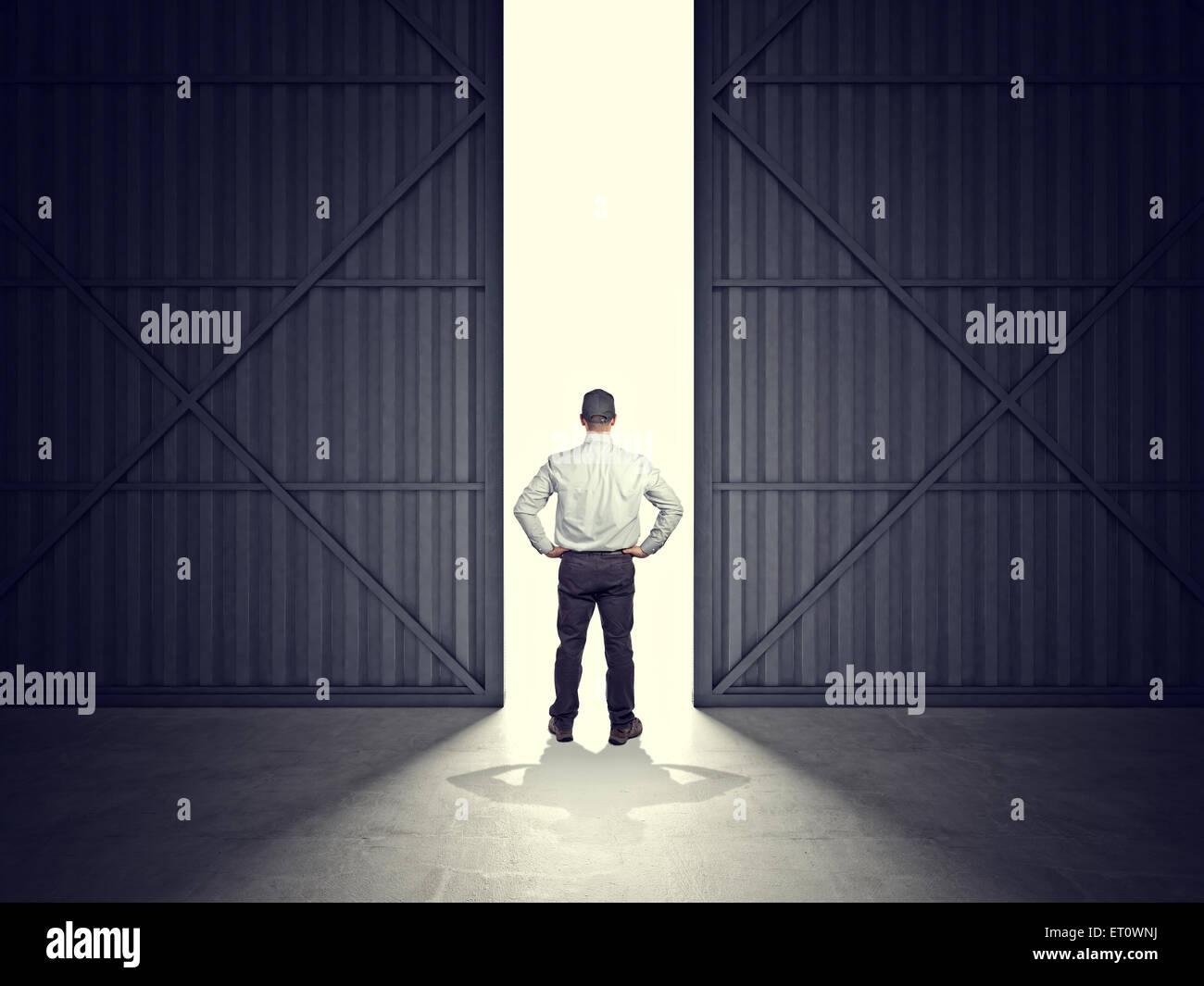 3d image of huge hangar doors and worker Stock Photo