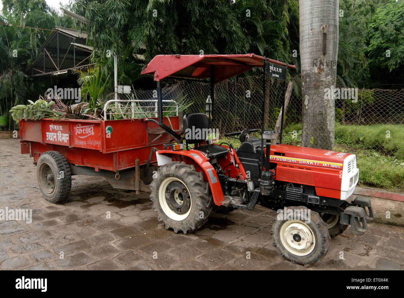Red colour tractor ; Mitsubishi Shakti MT 180 D with trolley at Saras Baug  ; Pune