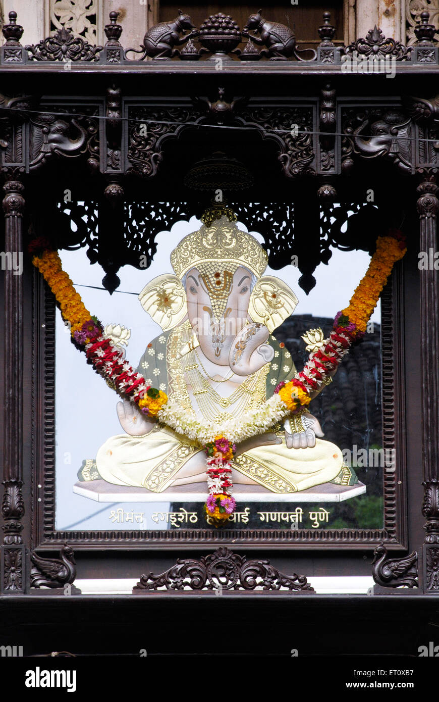 Image of Dagdu Seth Halwai Ganapati made by mirror and glass fitted in wood carved frame year 2008 Ganapati festival - Stock Image