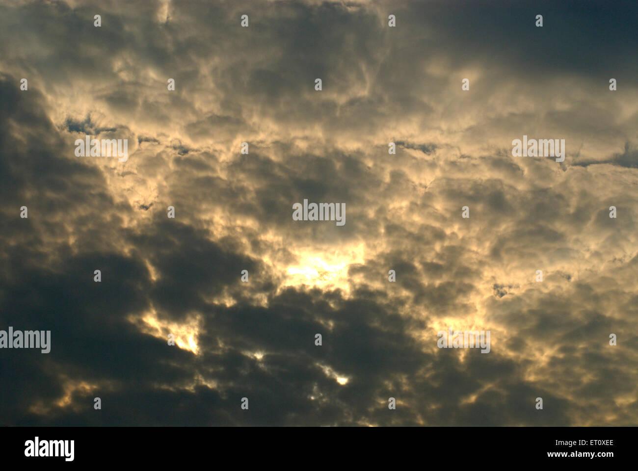 Colourful cloudy sky at sunrise ; Borivali ; Bombay Mumbai ; Maharashtra ; India - Stock Image